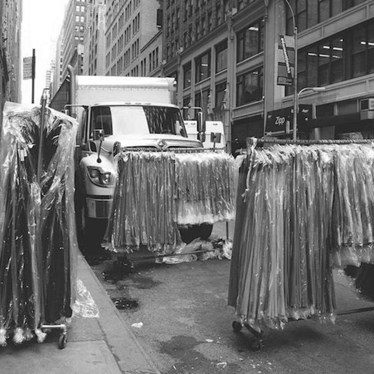 racks of clothes on the street in New York City's Garment District