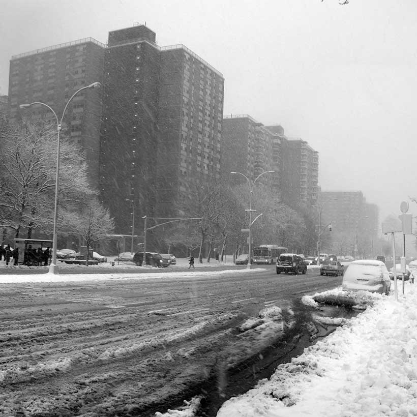 Road and sidewalk in East New York, Brooklyn, covered in snow. Photo: Wikimedia Commons, CCNY Geeks.
