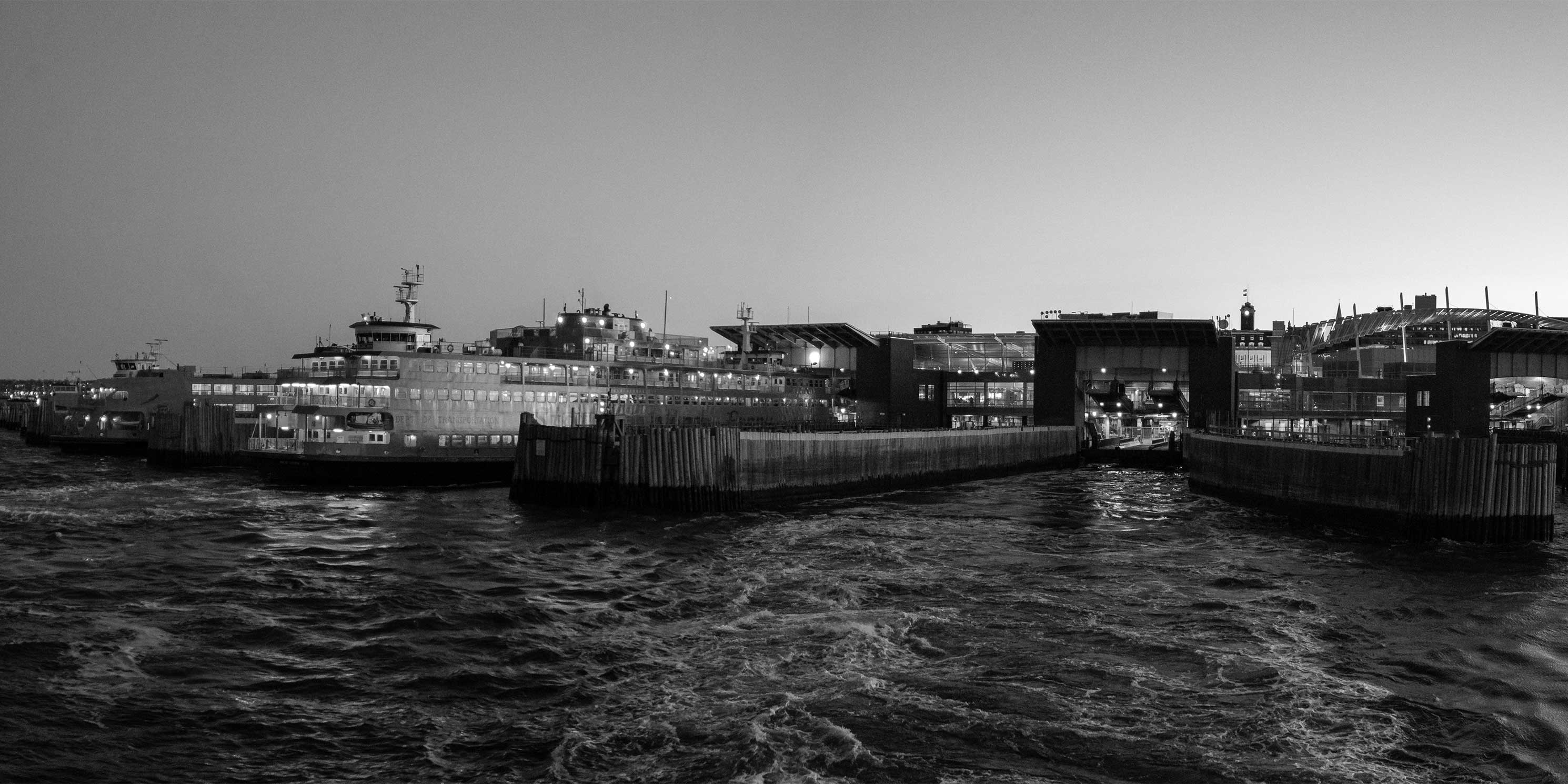 Panorama of the Staten Island Ferry Terminal at sunset. Photo: Wikimedia Commons, Eric Kilby.