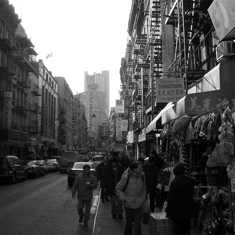 Busy shopping street in Manhattan's Chinatown. Photo: Wikimedia Commons, Philipp Schäufele.