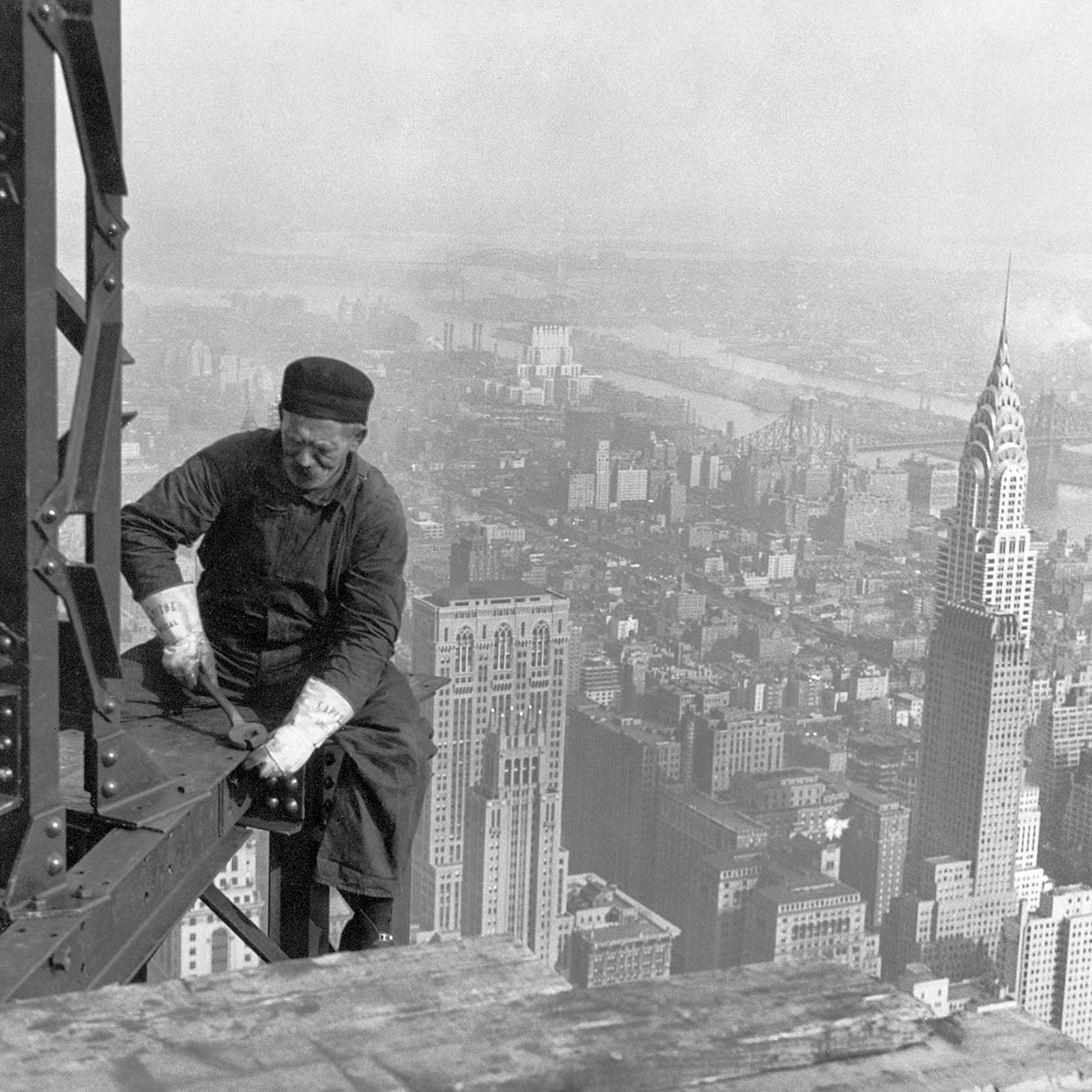 archival photo, steelworker on beam, builds skyscraper