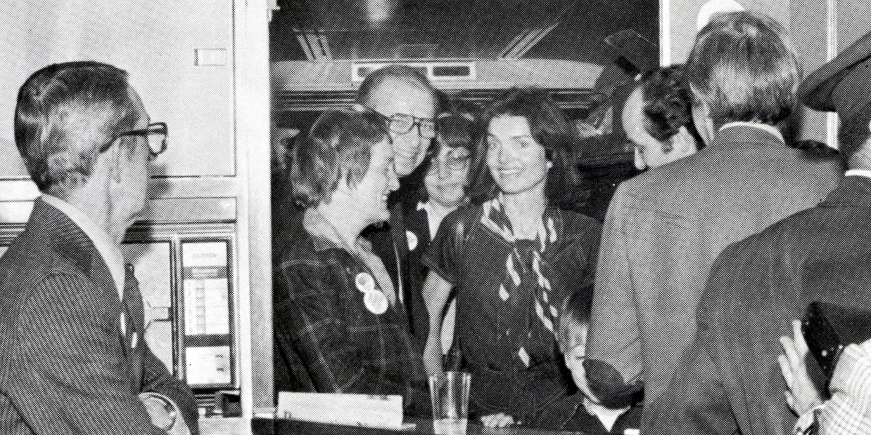 Jacqueline Kennedy Onassis on train with supporters