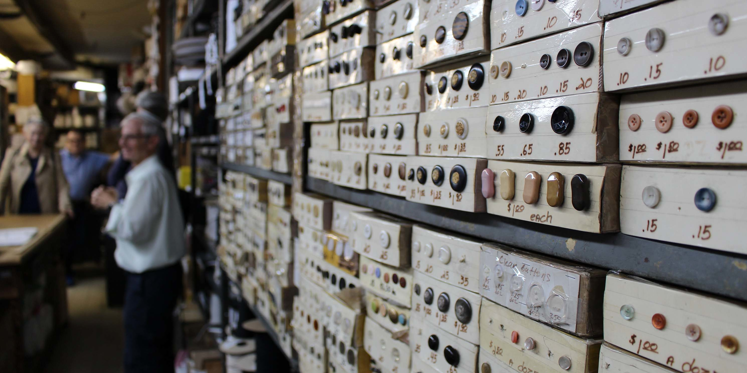buttons on display wall at Garment District shop