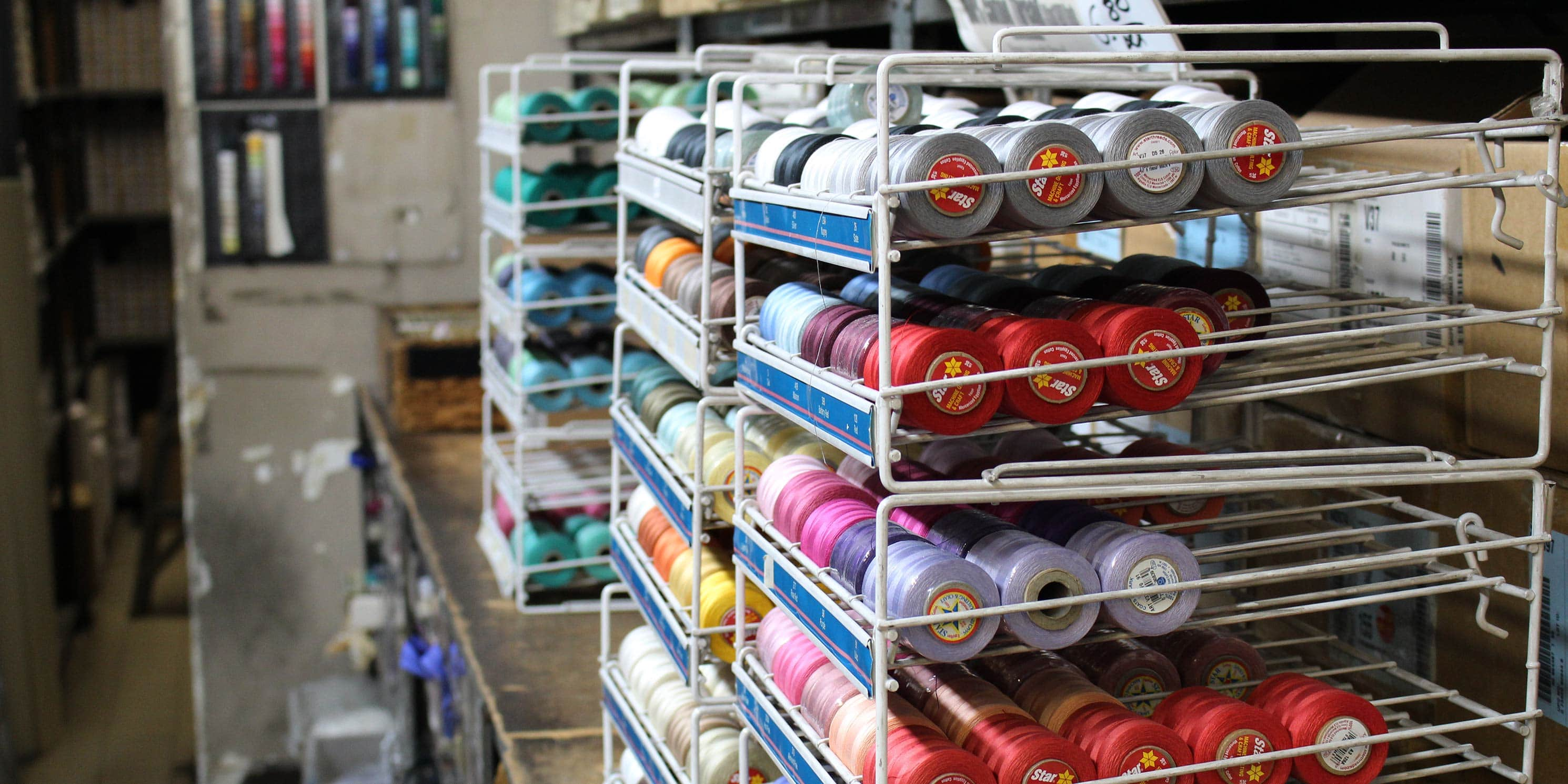 spools of thread on racks in Garment District shop