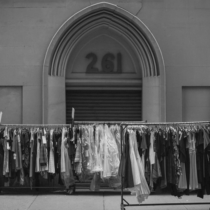 Clothes on racks during a street sale on 35th street in Manhattan's Garment District. Photo: Creative Commons, Michael Tapp.