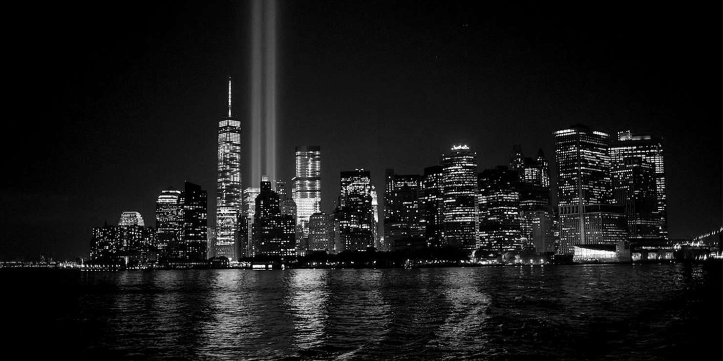 Tribute in Light spotlight beams shine into the night sky in Lower Manhattan