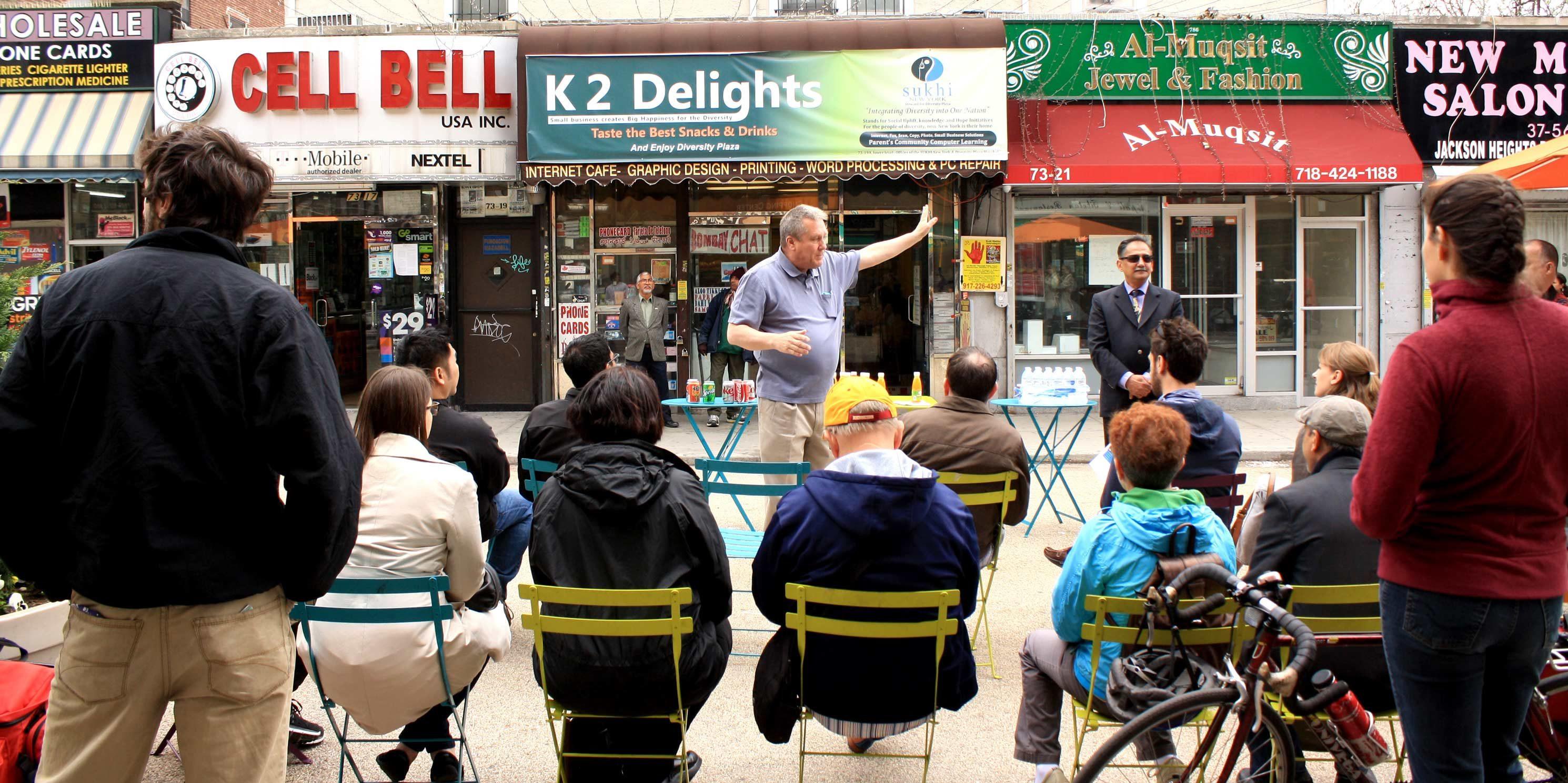 Danny Dromm speaks during a Jane's Walk in Queens