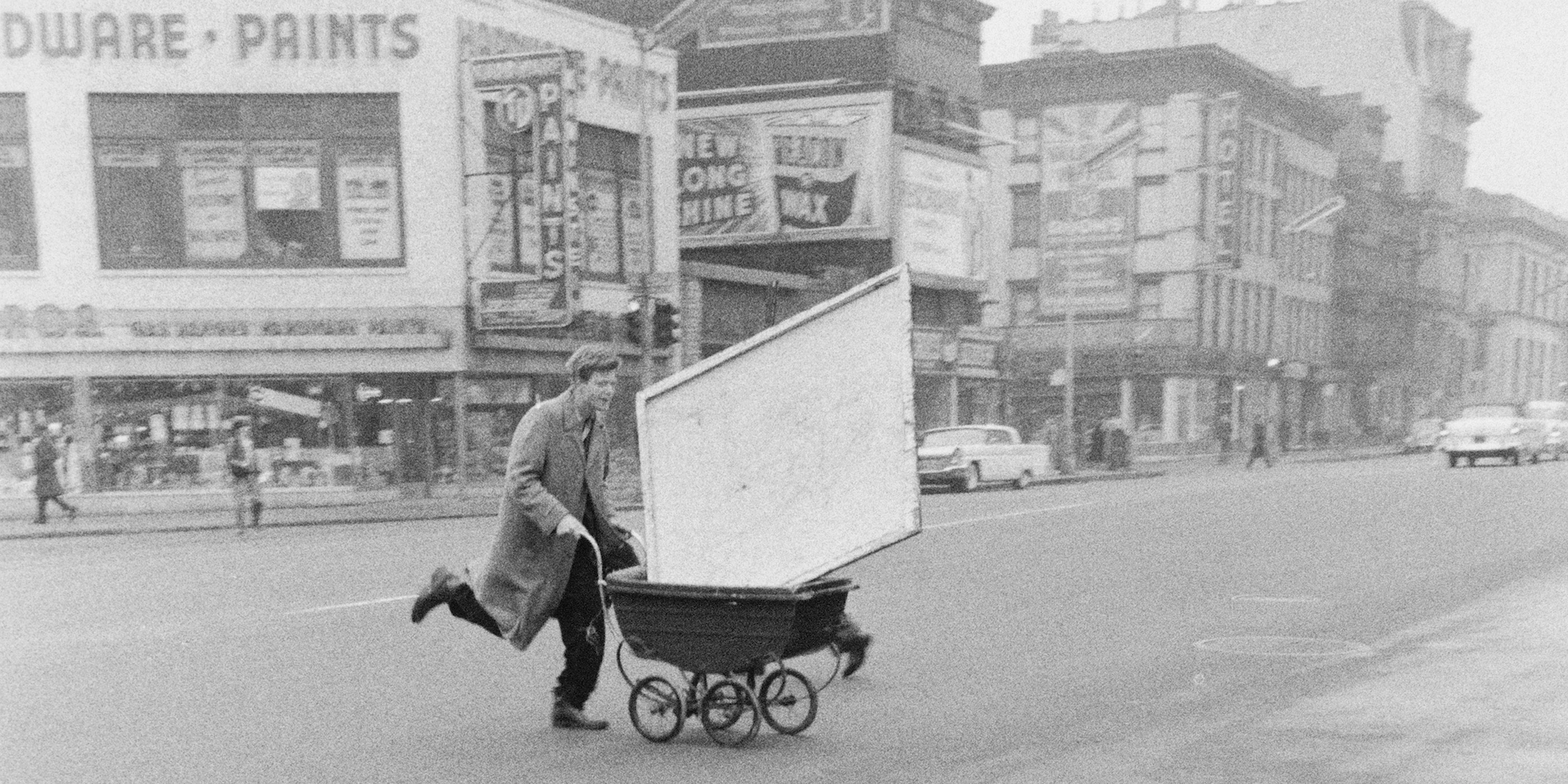 Red Grooms transporting artwork to Reuben Gallery, New York, 1960.