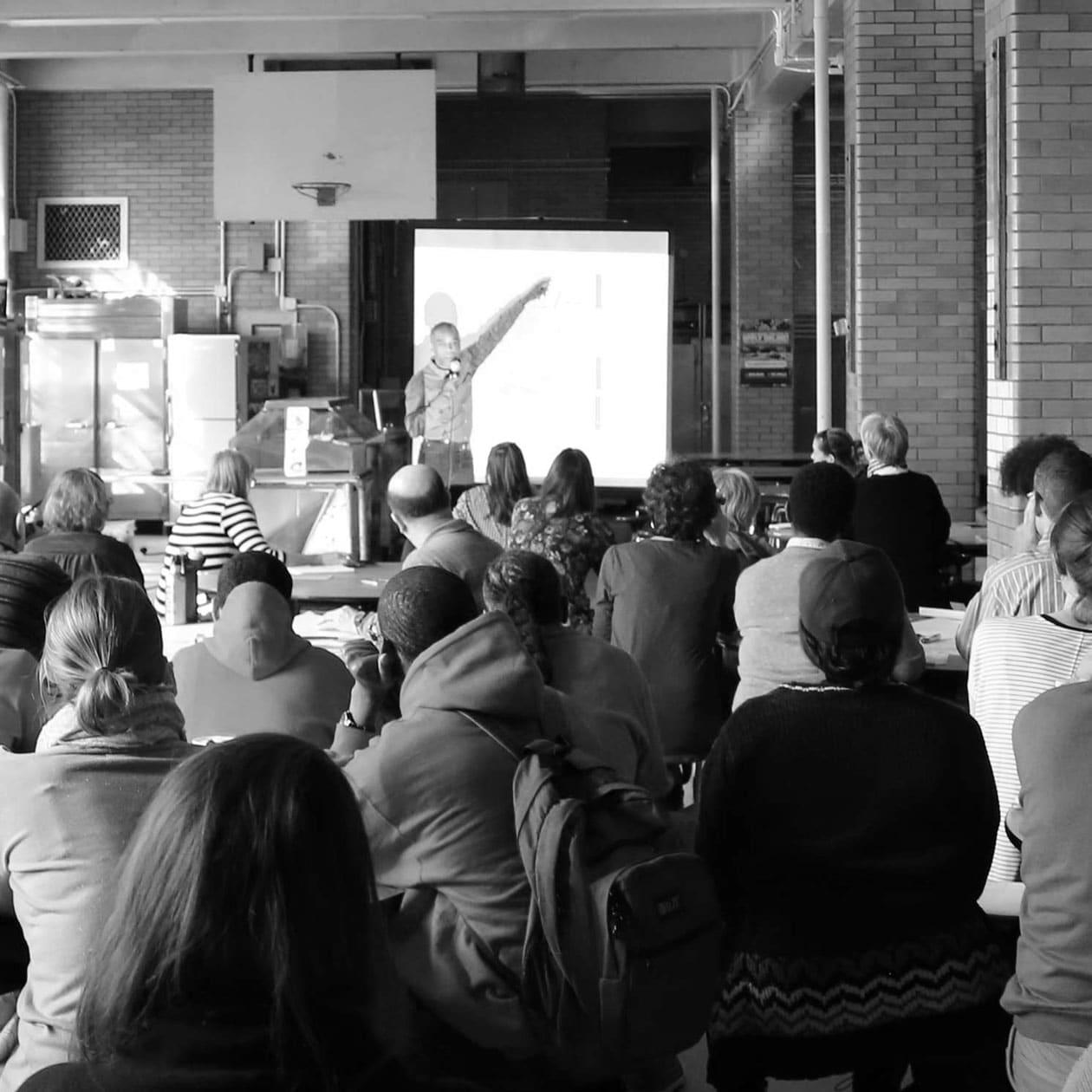 speaker and audience at workshop