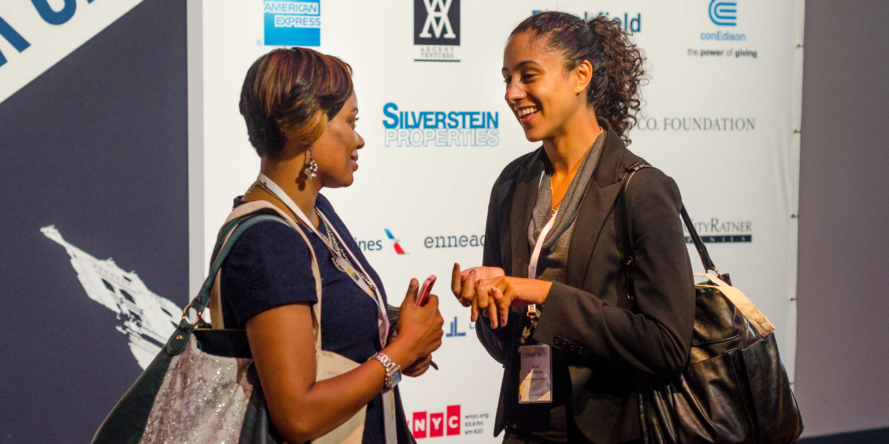 two young women talk at the Summit