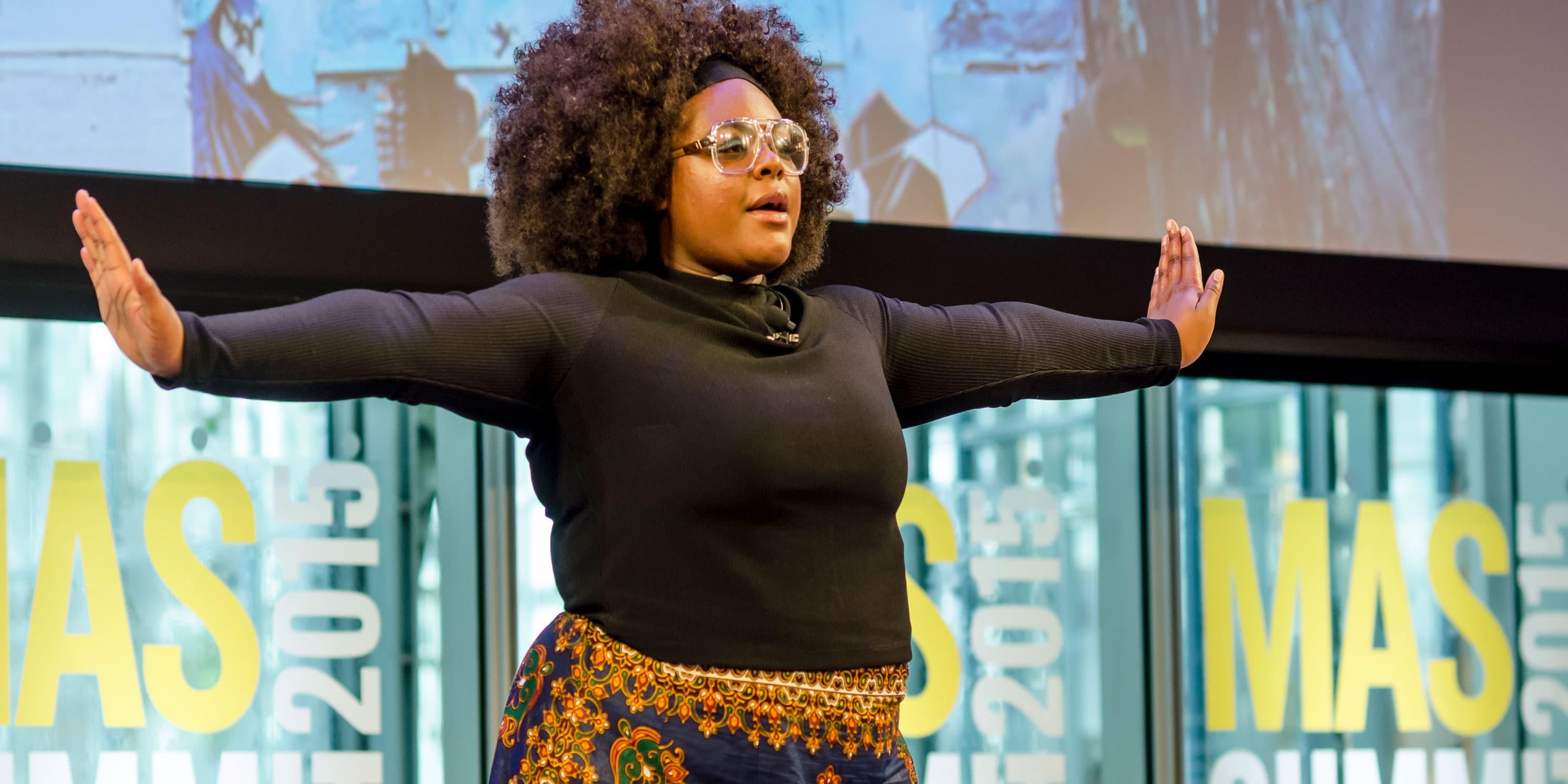 Poet Alyssa Saunders on stage at the Summit