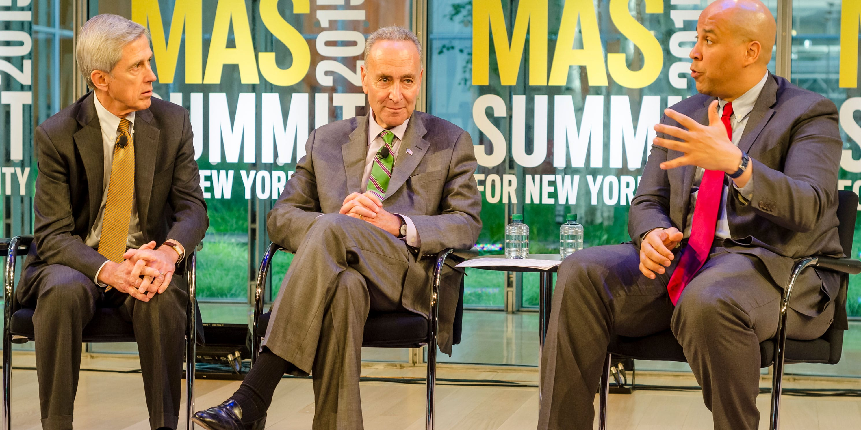 Chuck Schumer and Cory Booker on stage at the Summit
