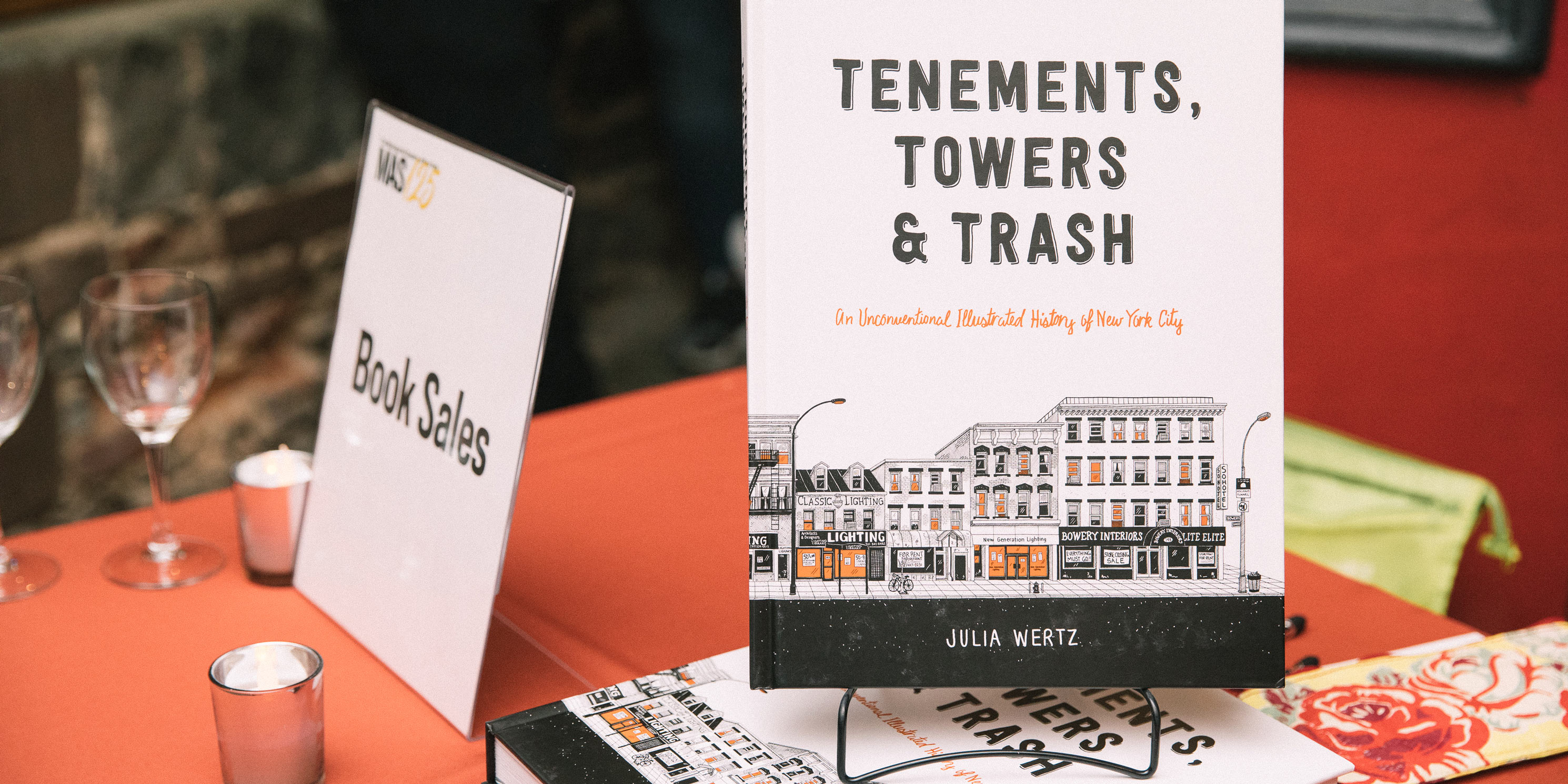 Tenements, Towers & Trash: An Unconventional Illustrated History of New York, by Julia Wertz displayed on table