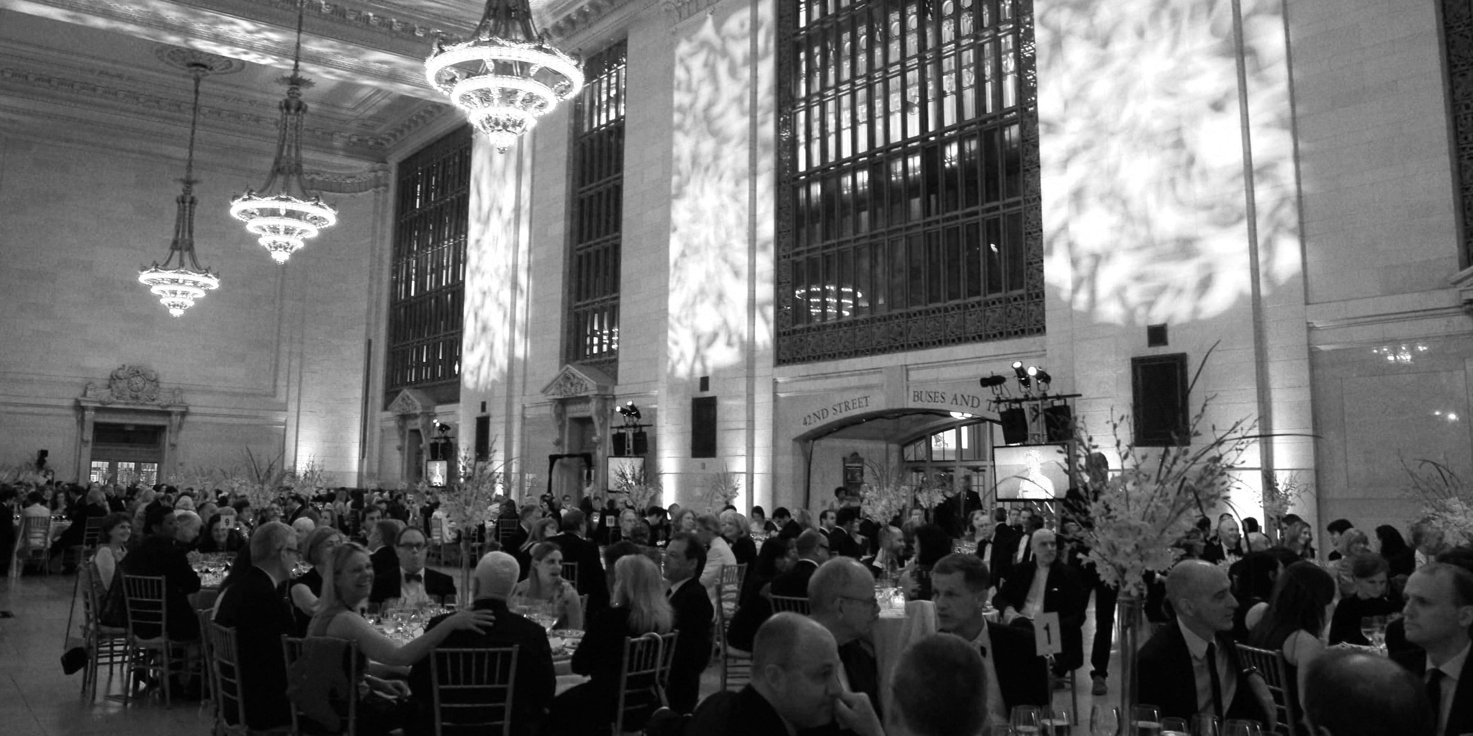 people dine at tables in Vanderbilt Hall, within Grand Central Terminal