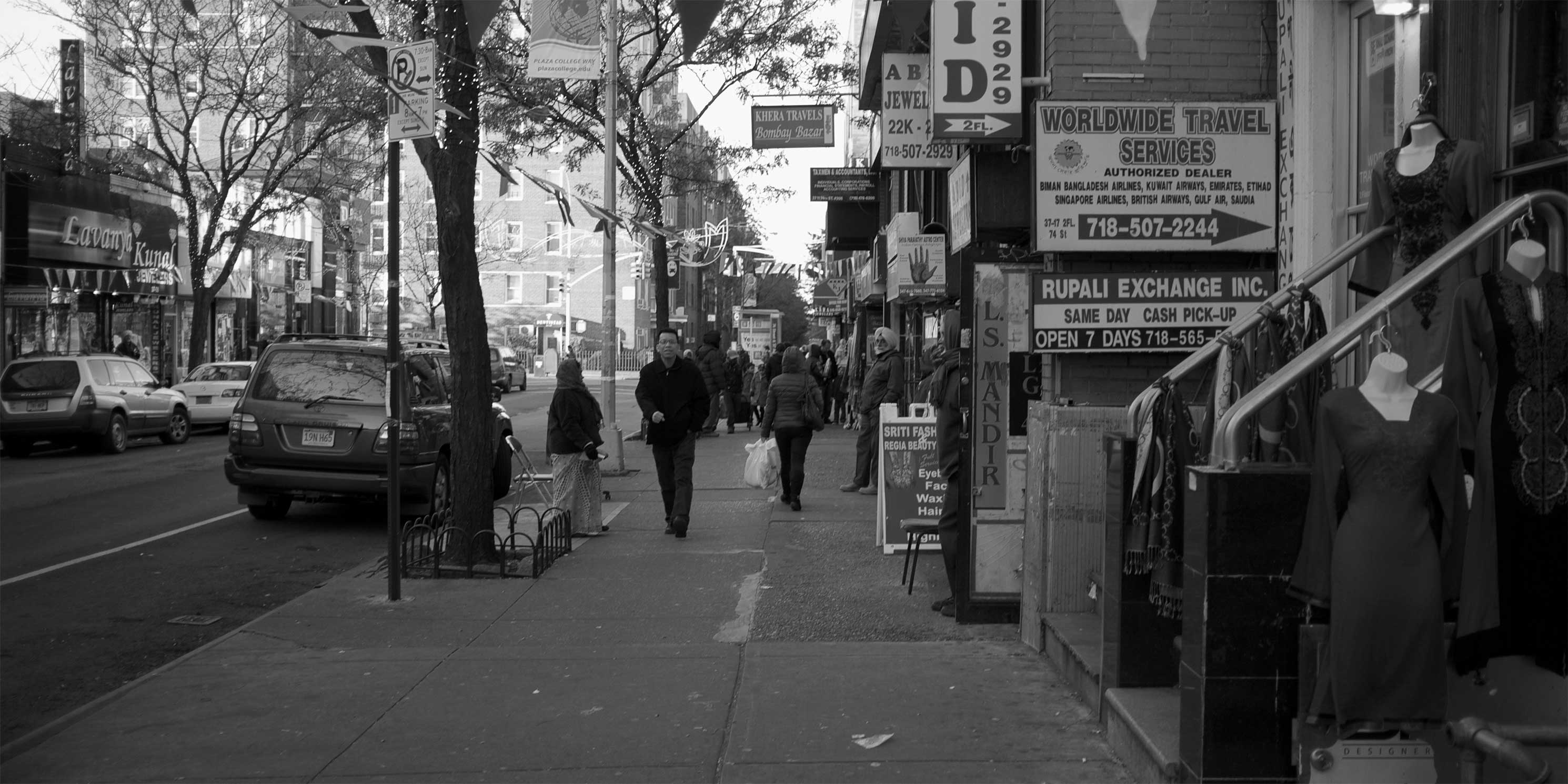 A street in the Jackson Heights neighborhood of Queens. Photo: Creative Commons, Aleksandr Zykov. Modifications: Image cropped and transformed to black and white.
