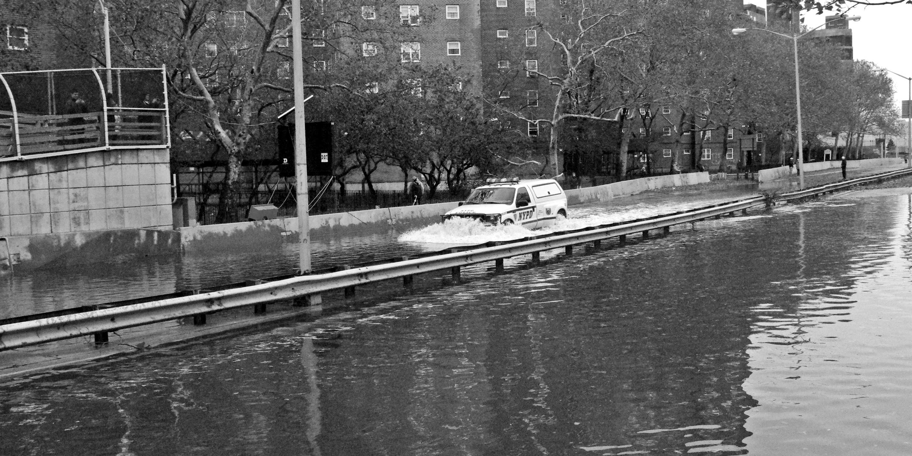 A NYPD van drives down the FDR flooded from Hurricane Sandy in 2012. Photo: Wikimedia Commons, David Shankbone.