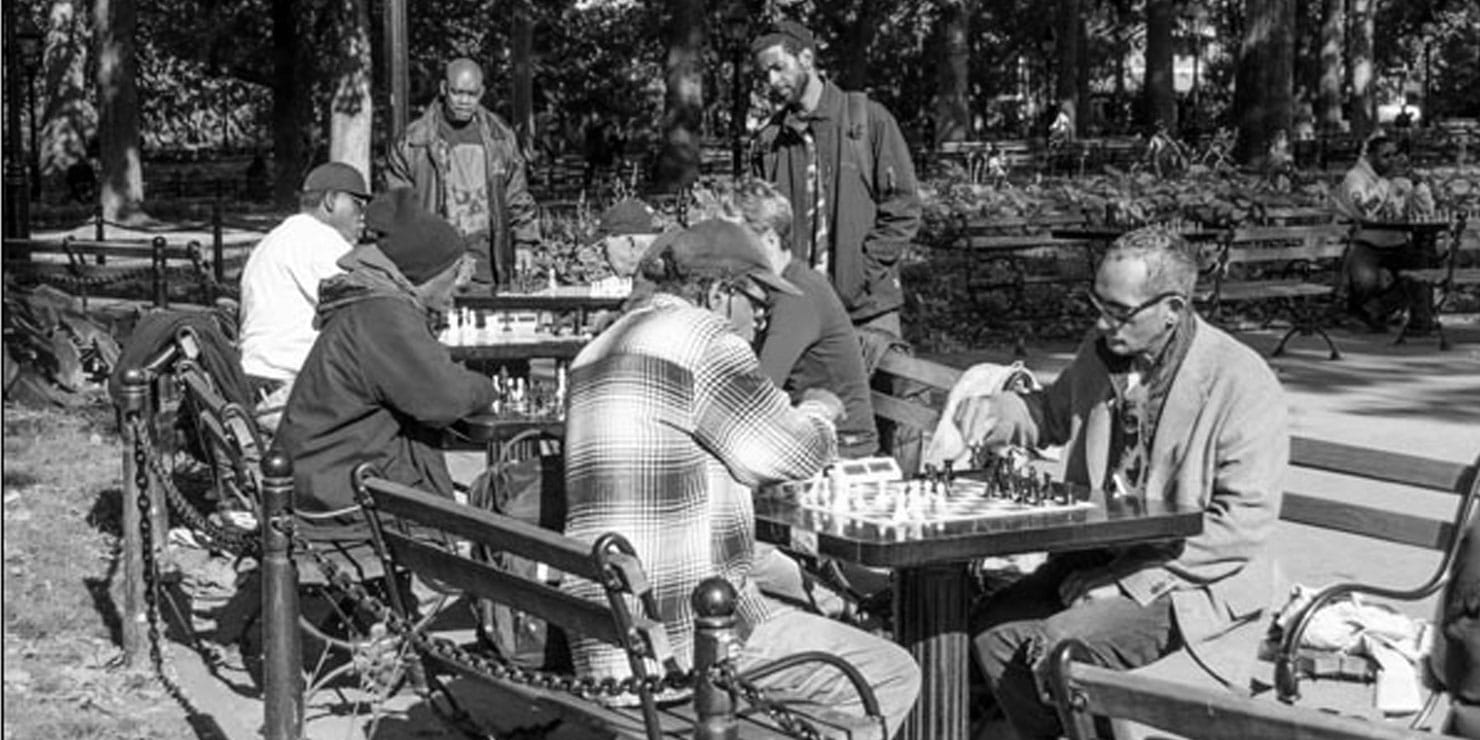 Men playing chess in the park. Photo: Giles Ashford.