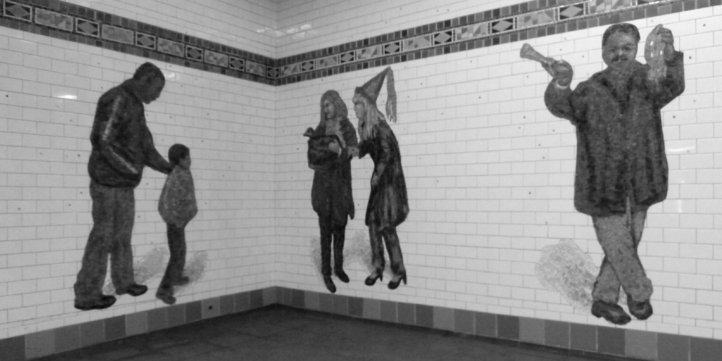 a tile mural in a subway station