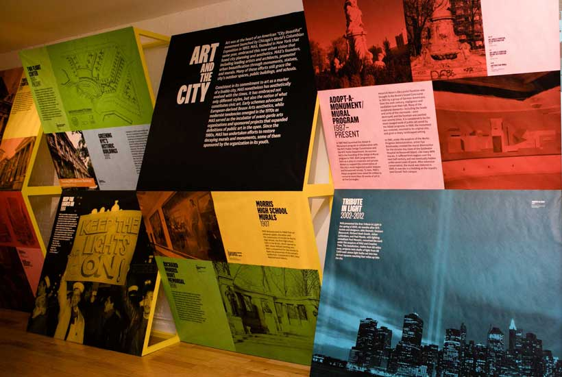 panels of artwork at the Toward a Livable City exhibit