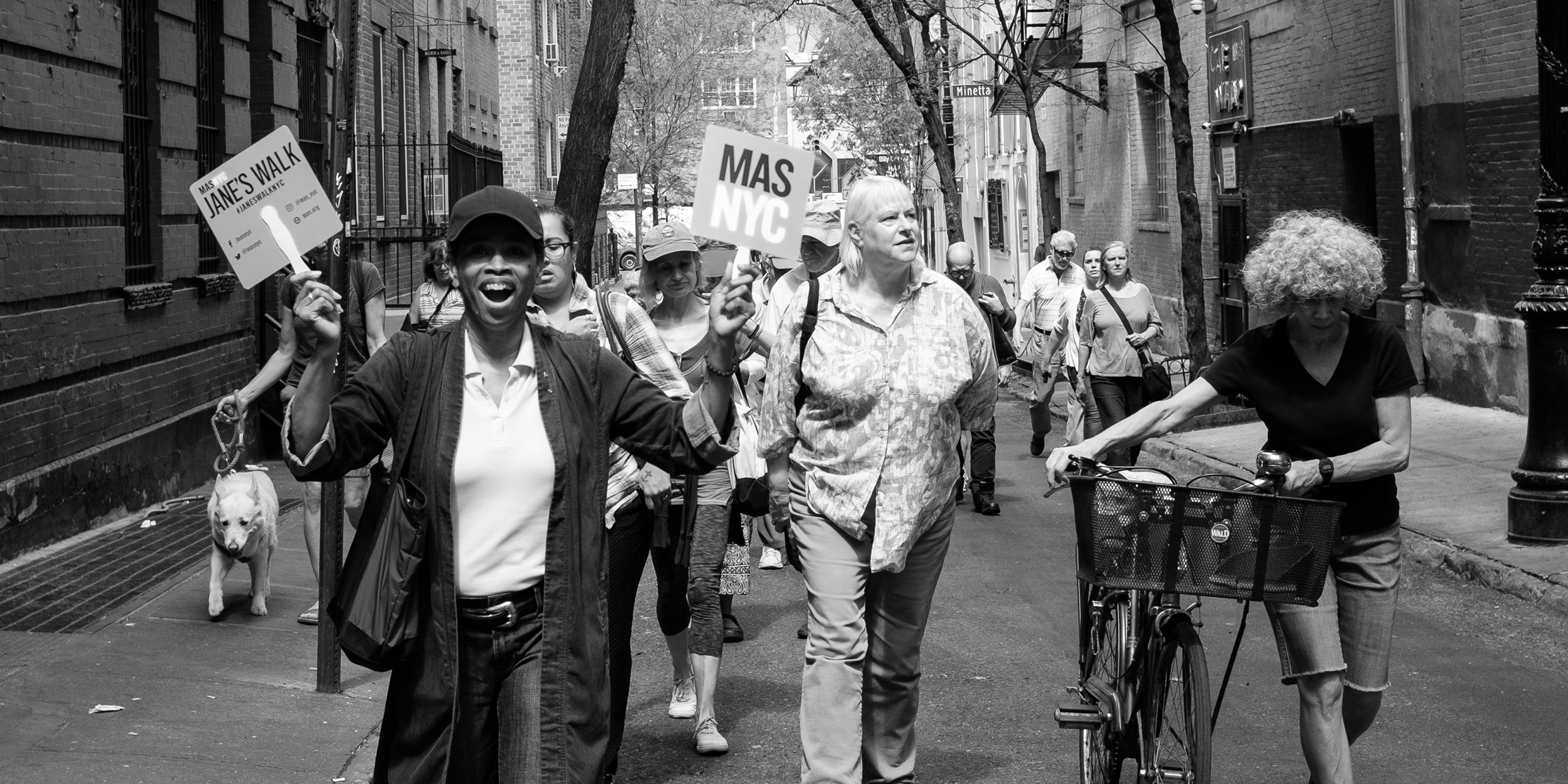 a leader and walkers on a Jane's Walk in Greenwich Village