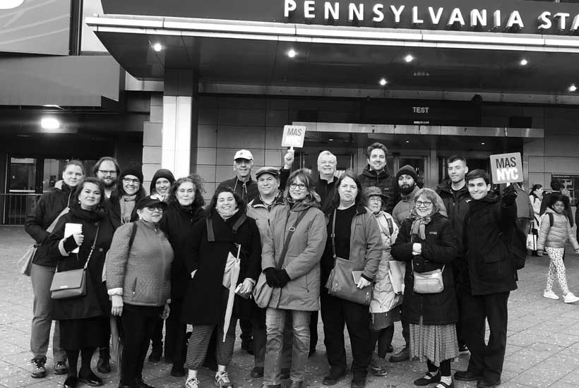 people on a Jane's Walk training tour outside Penn Station