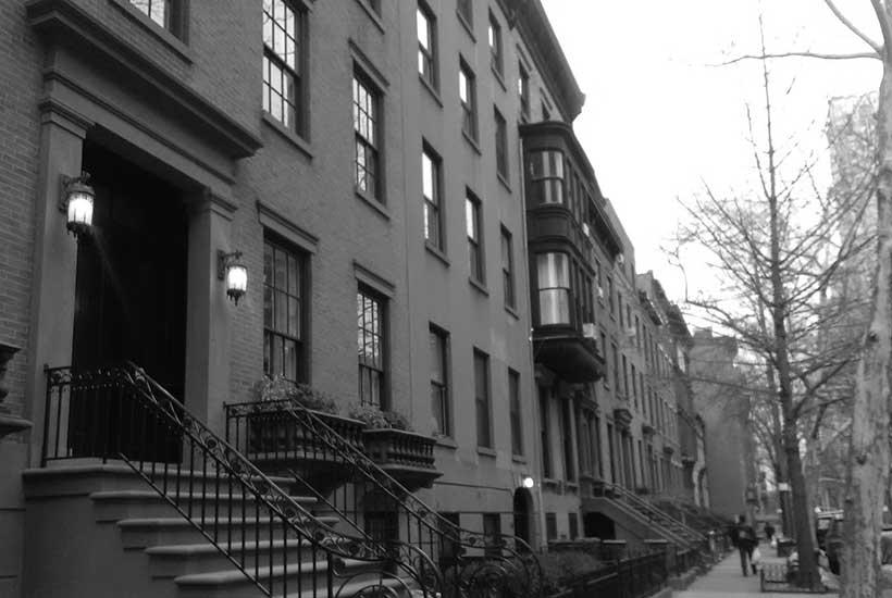row of brownstone buildings in New York City