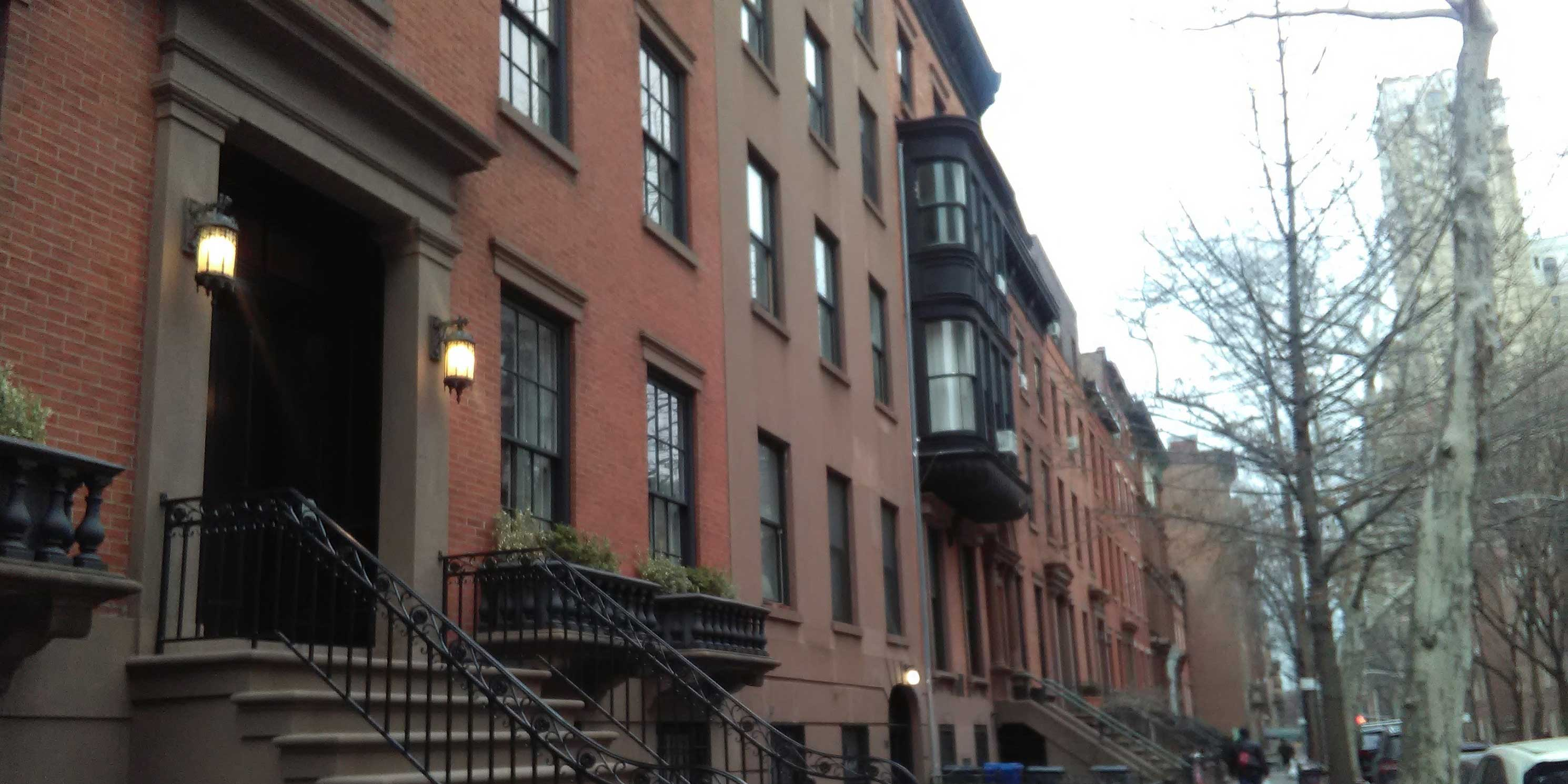 row of brownstone buildings in New York City