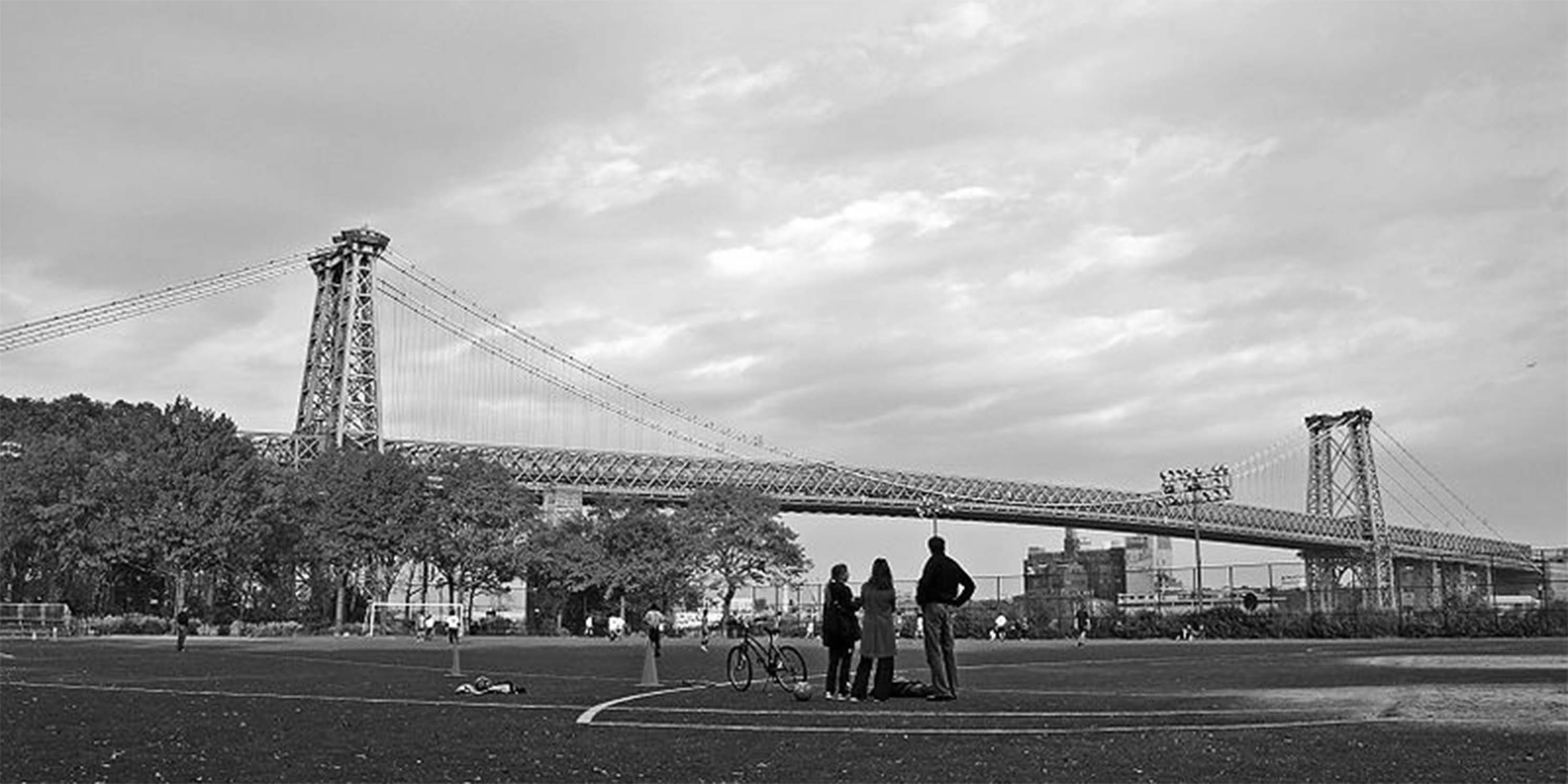 people on a sports field at East River Park in Fall