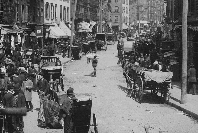 Carts and wagons on street in Mulberry Bend, New York