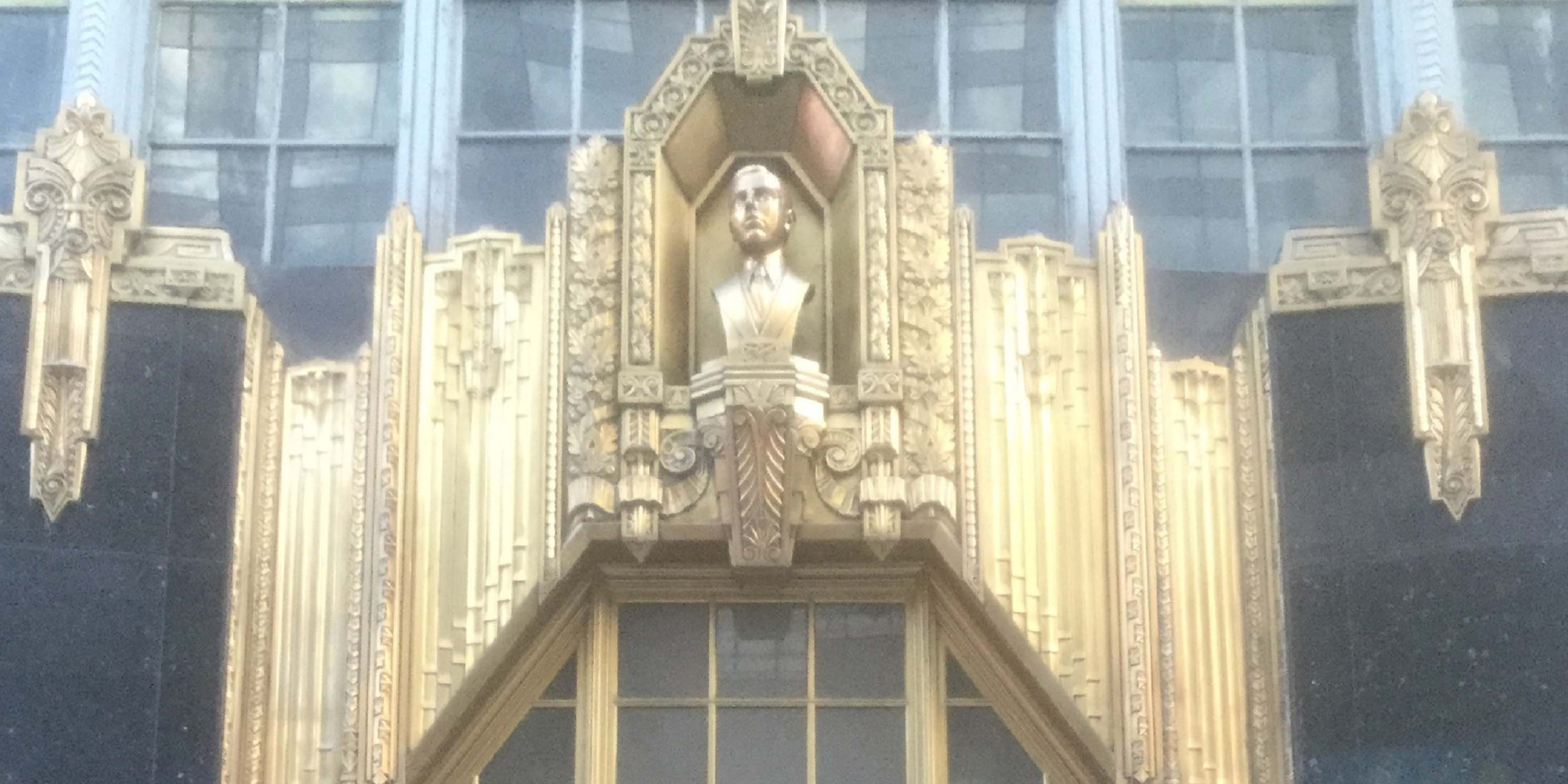 Bust on the exterior of the Brill Building
