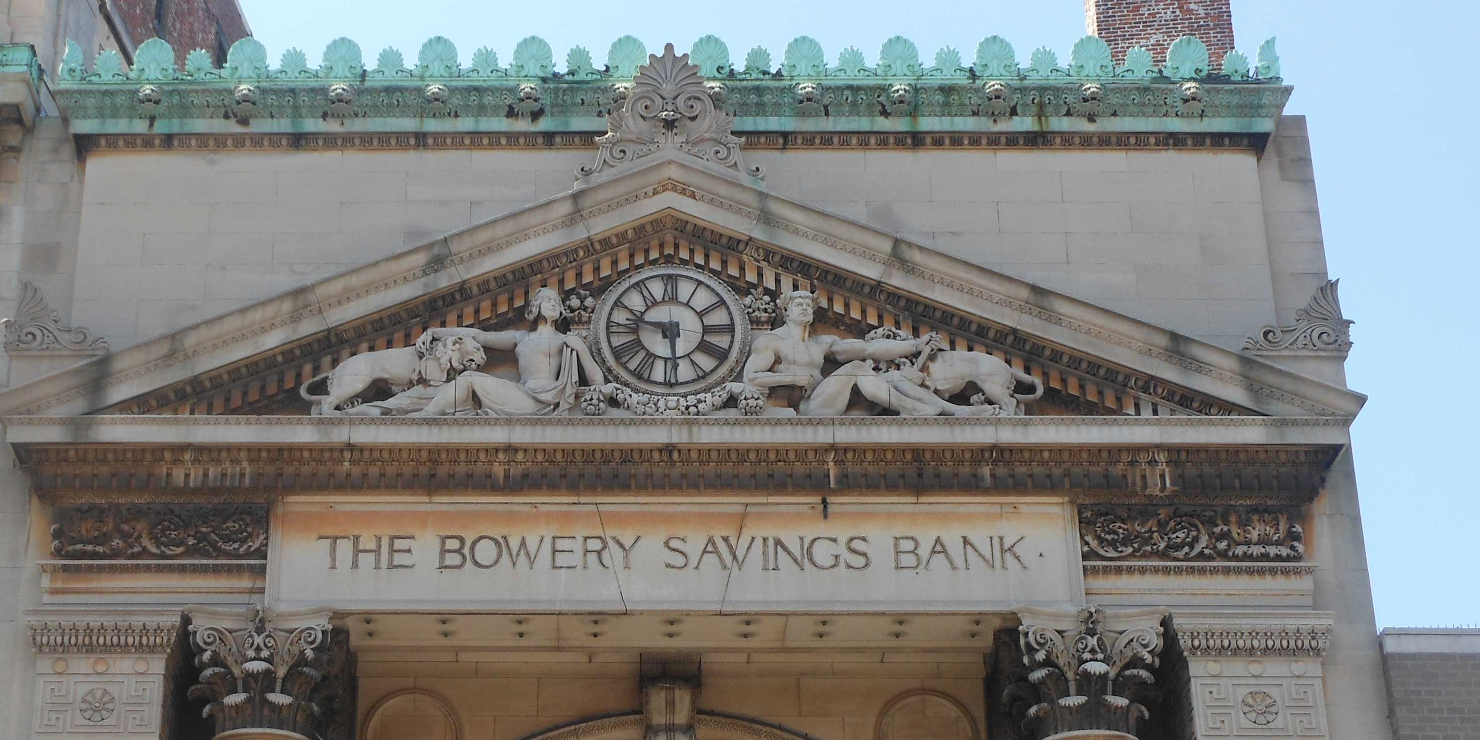 carved stone exterior of Bowery Savings Bank