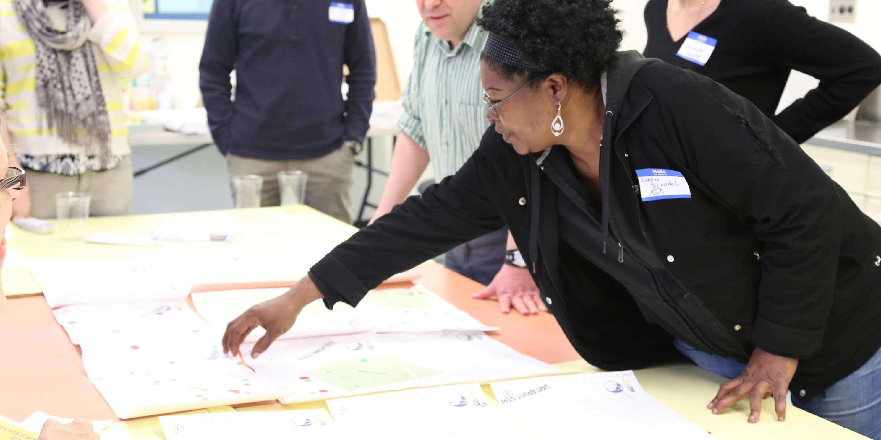 workshop participants review maps