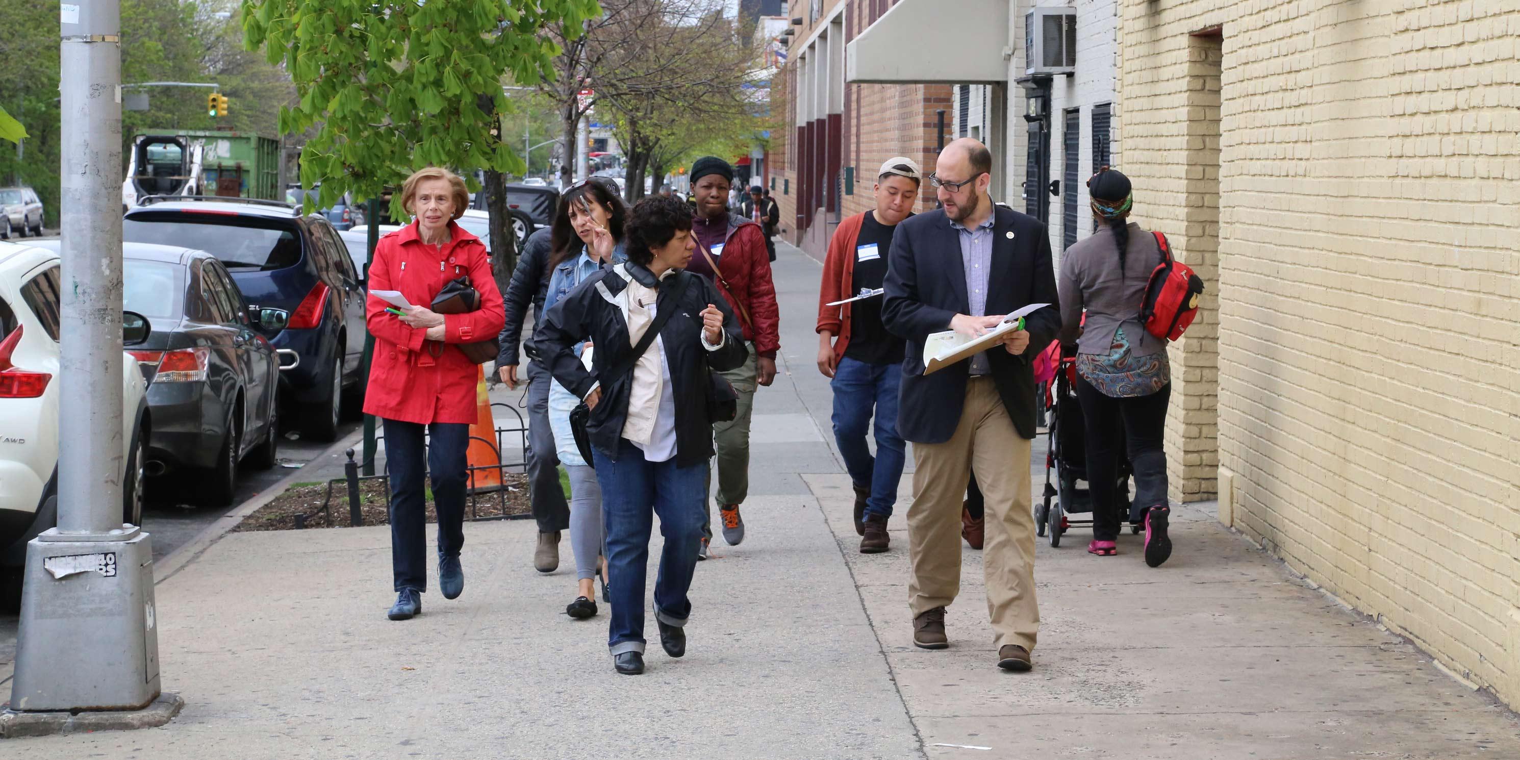 workshop participants walk down sidewalk