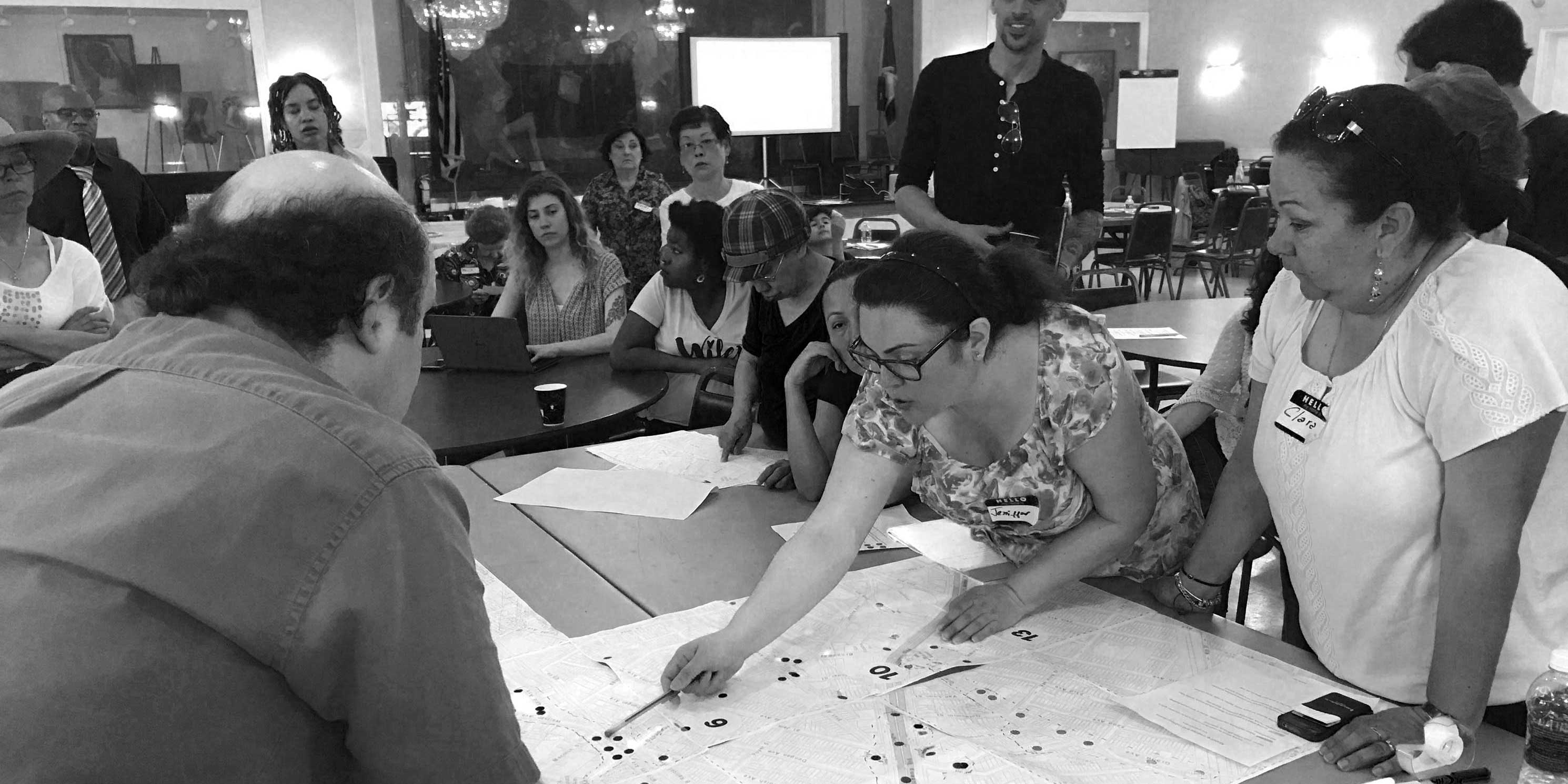 members at a Livable Neighborhoods workshop inspect a map