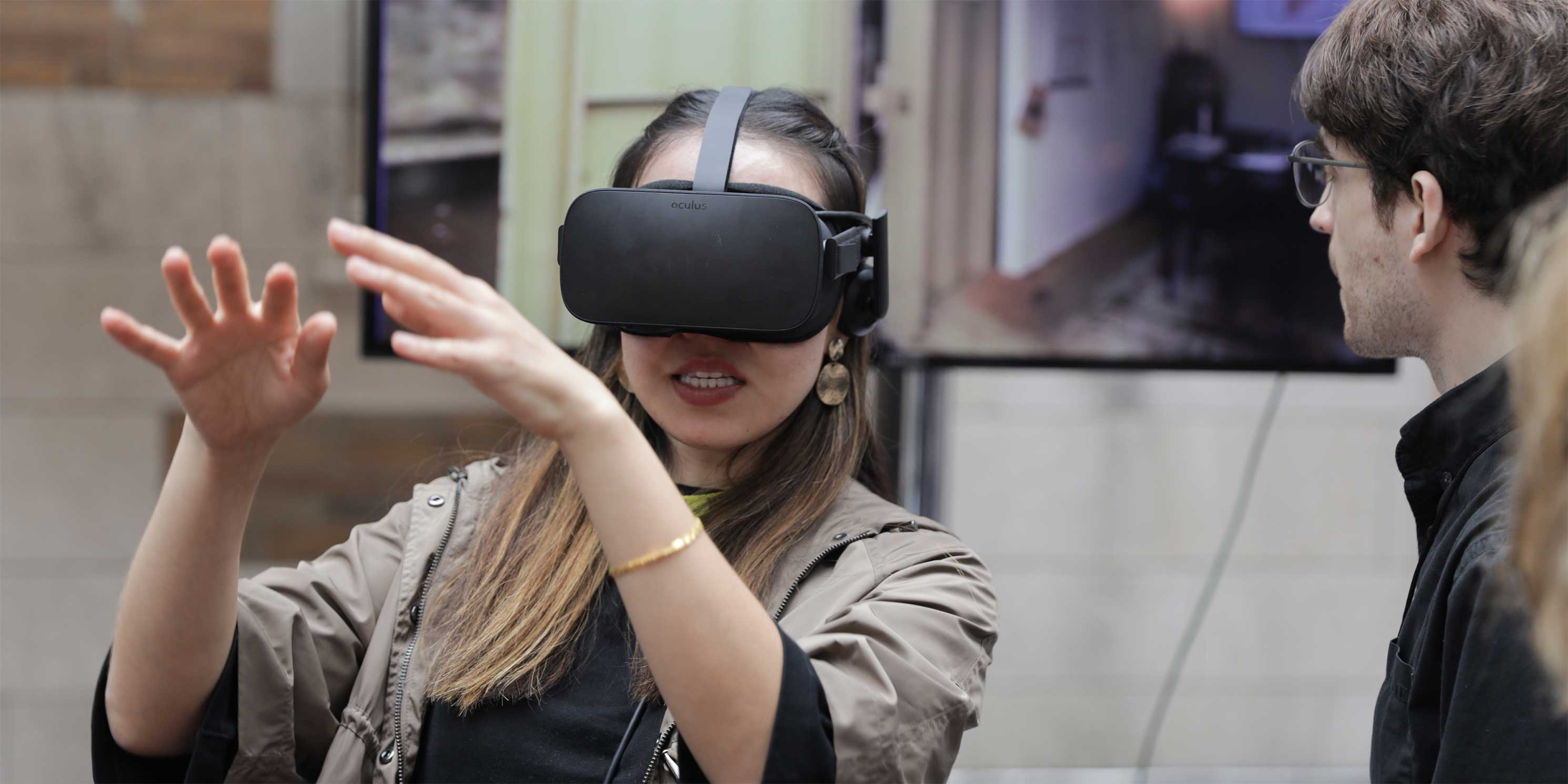a woman wears virtual reality goggles at the Summit