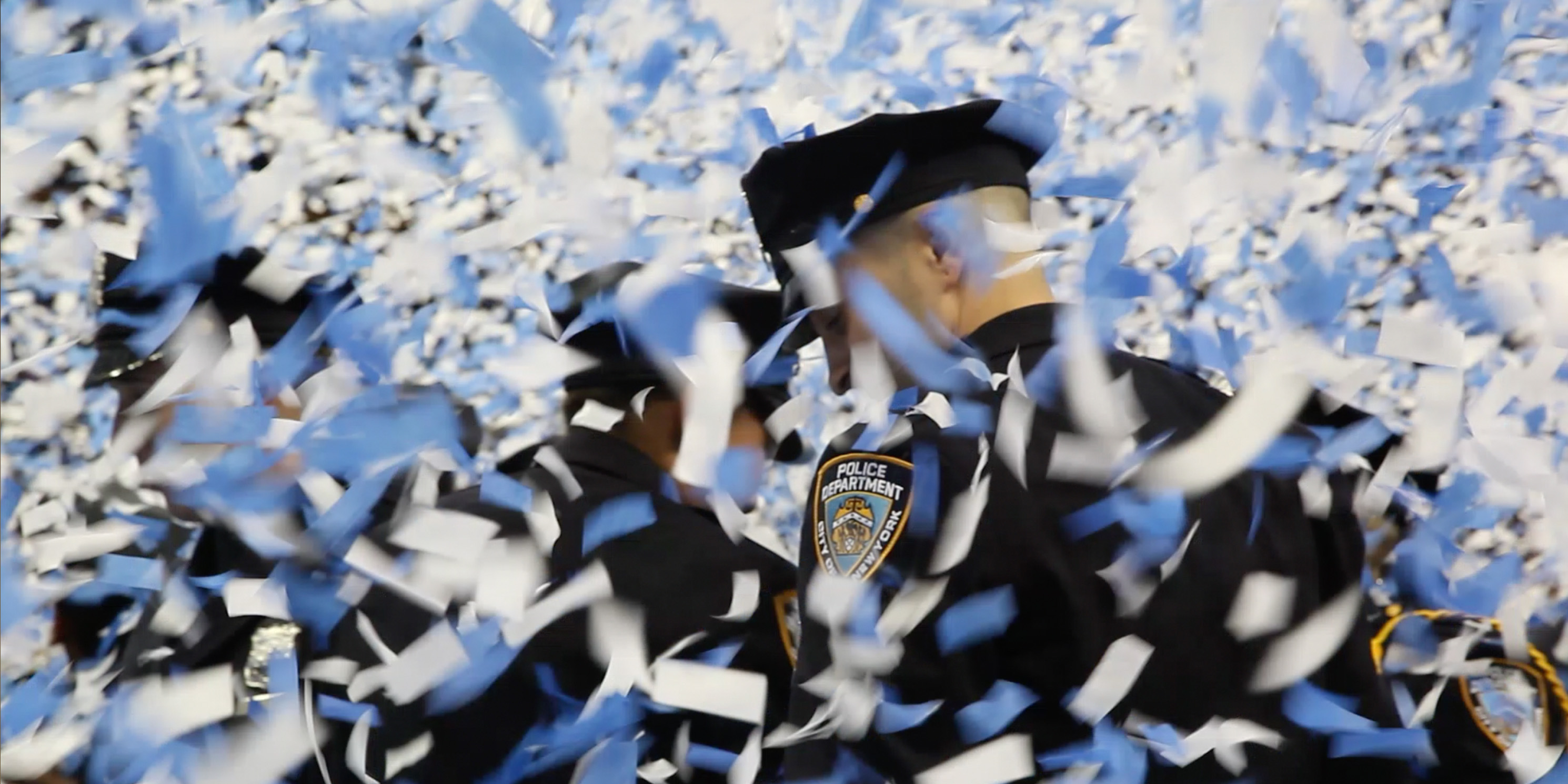 still from the movie Crime and Punishment, police officer walk through ticker tape
