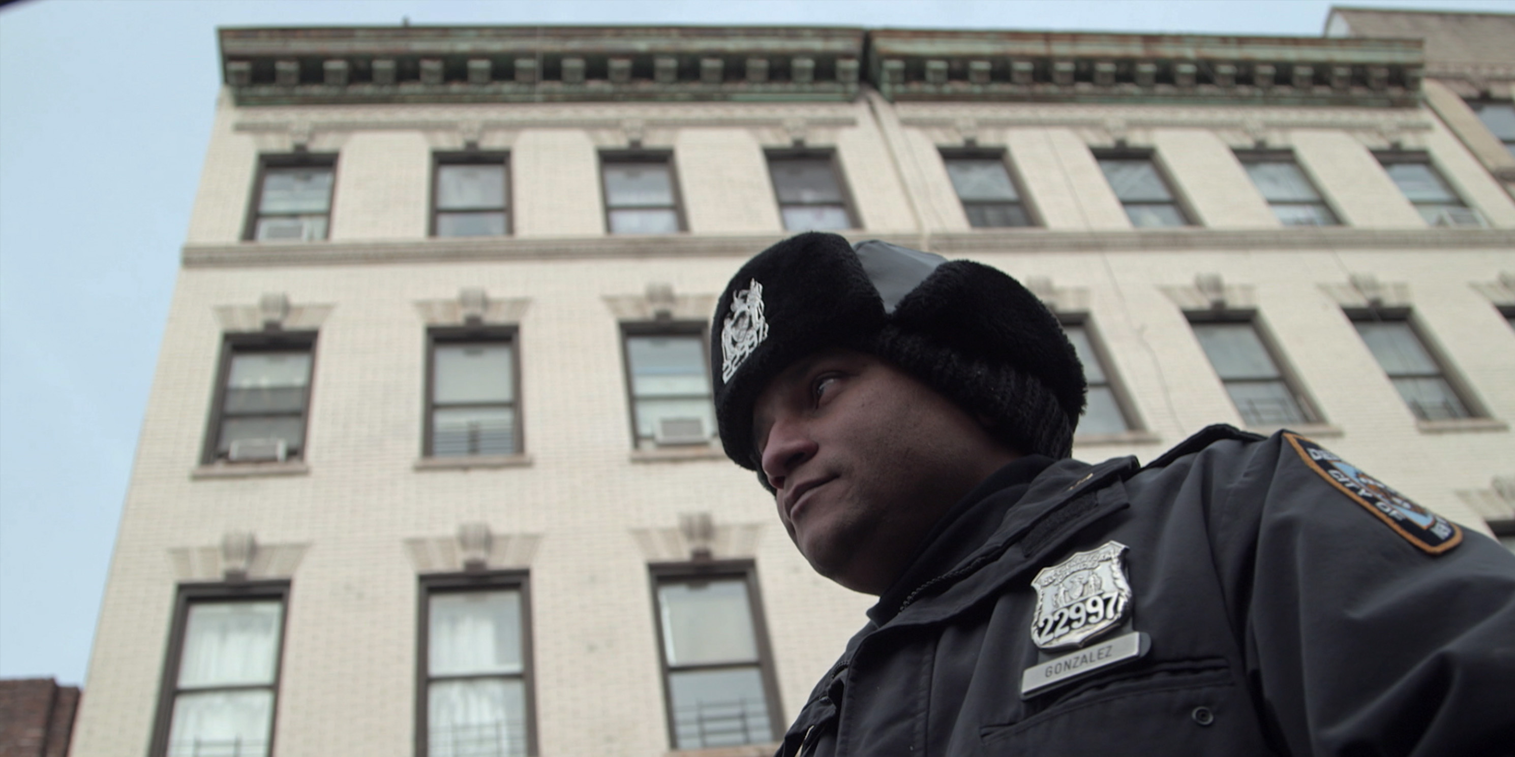 still from the movie Crime and Punishment, police officer outside building