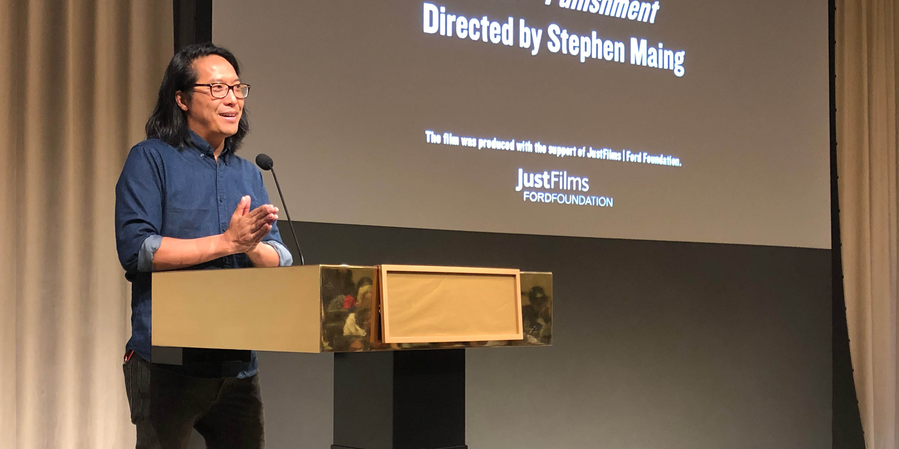 Director Stephen Maing speaks during a screening of the movie Crime and Punishment