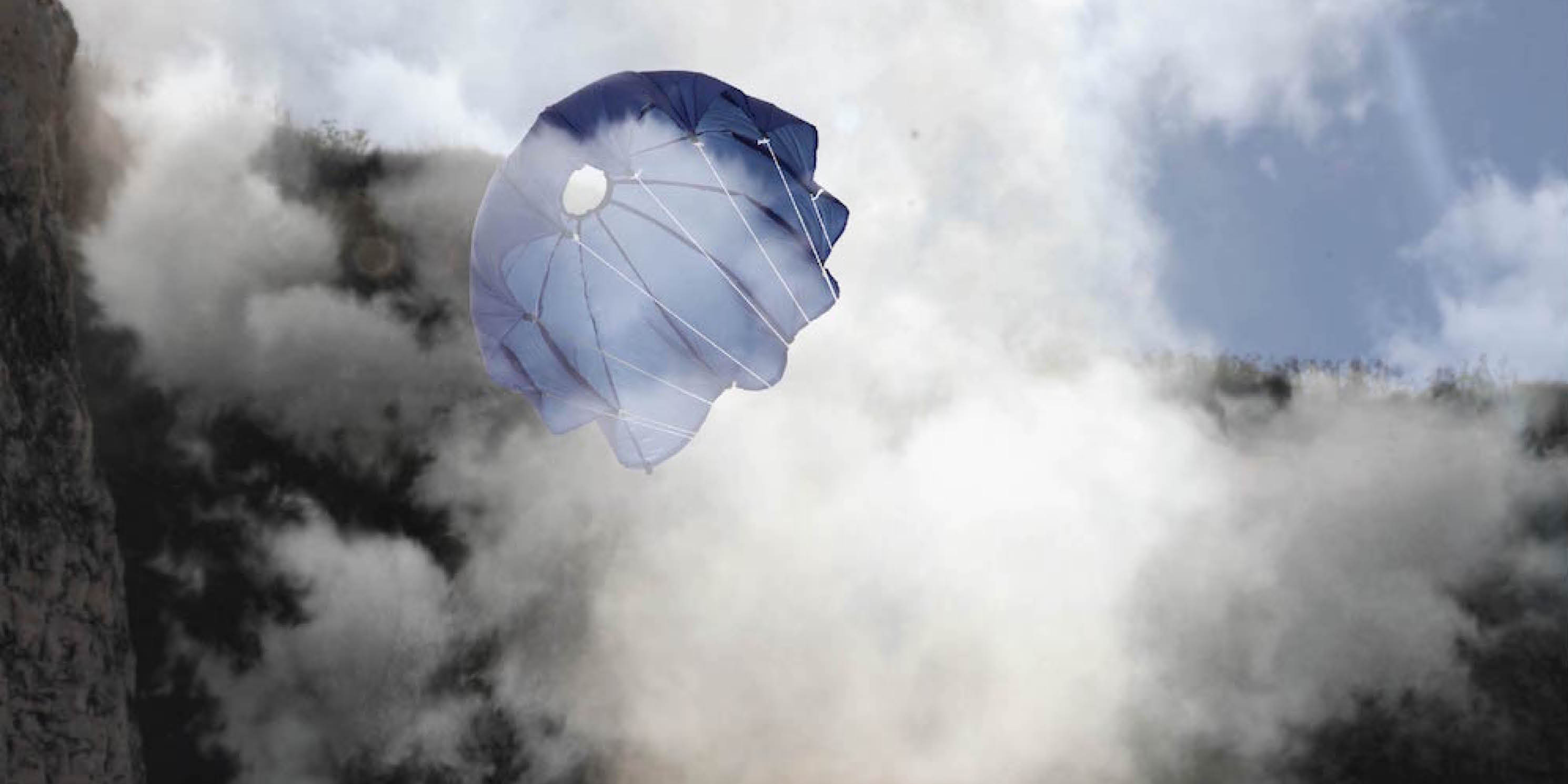a parachute surrounded by clouds