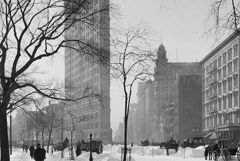 Flatiron building with snow on the ground, 1905