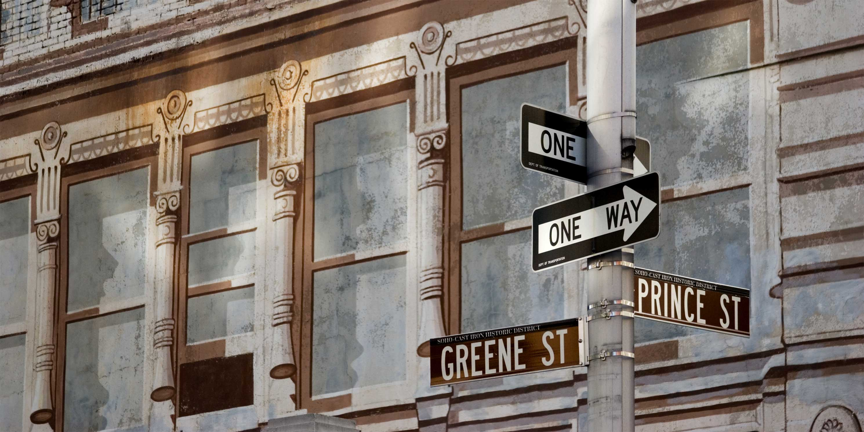 street signs for Greene Street and Prince Street