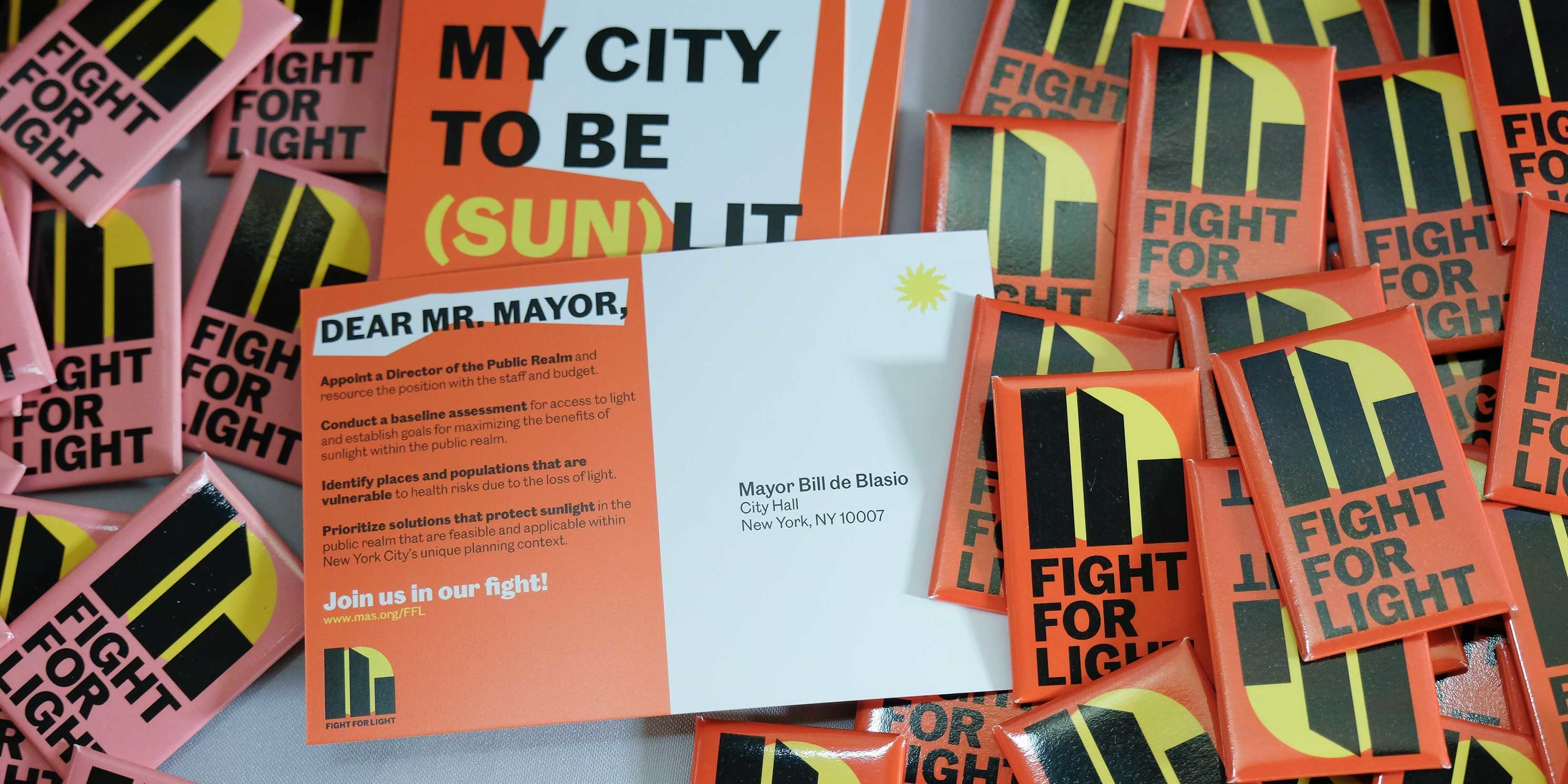 pins and postcards for the Fight for Light campaign