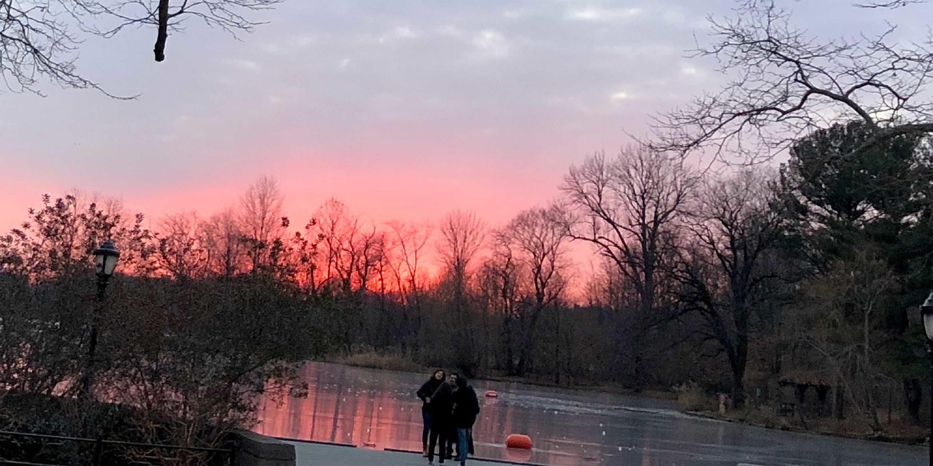 people enjoy a winter sunset in Prospect Park