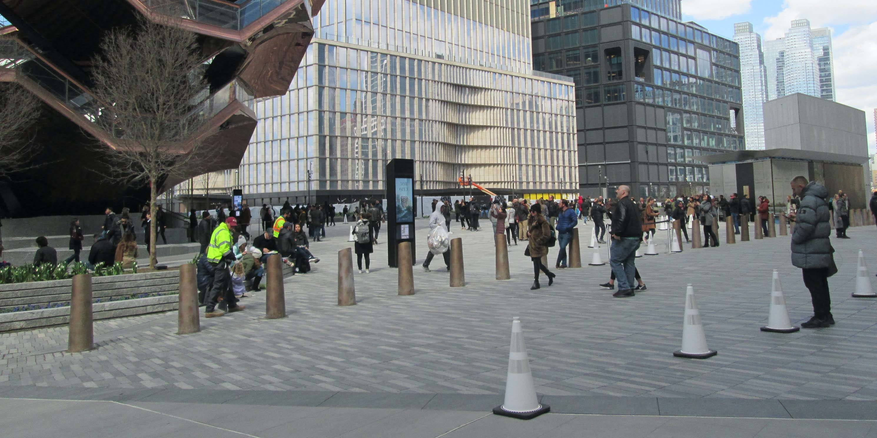 plaza with pedestrians in Hudson Yards