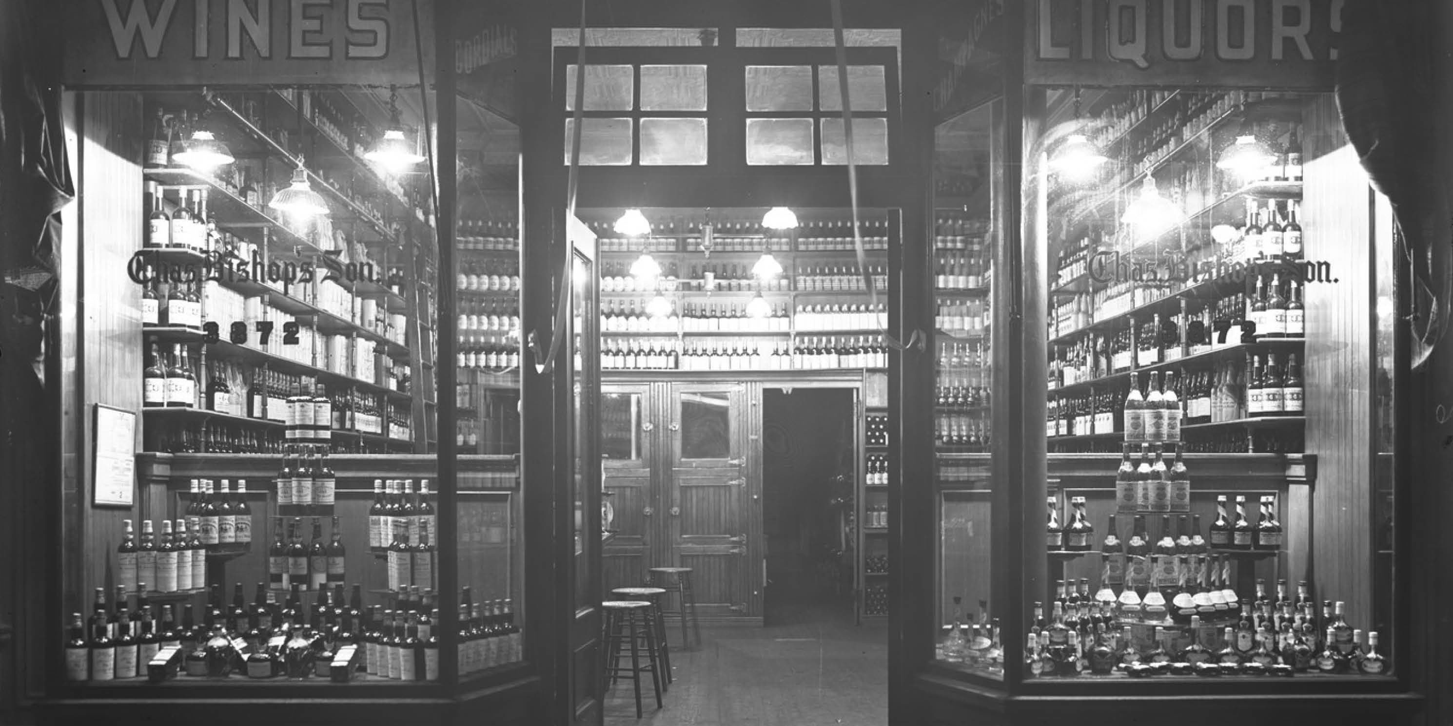archival photo of a wine and liquor store's front windows