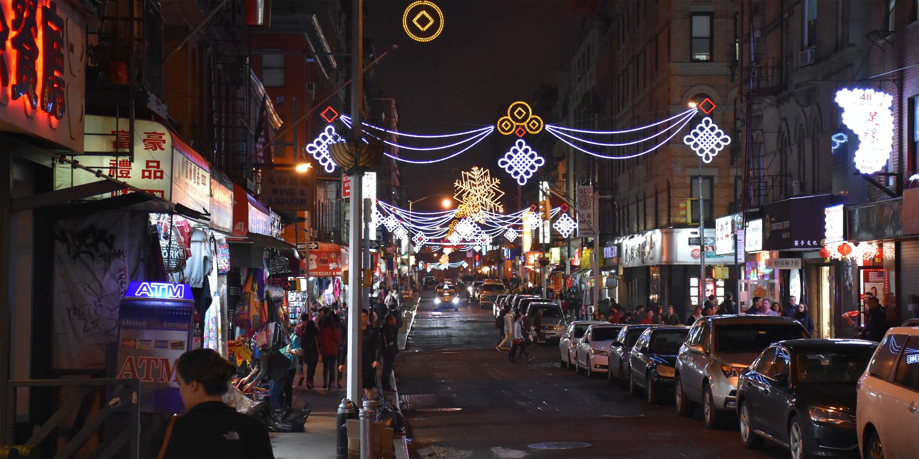 Mott Street at night with festive lights