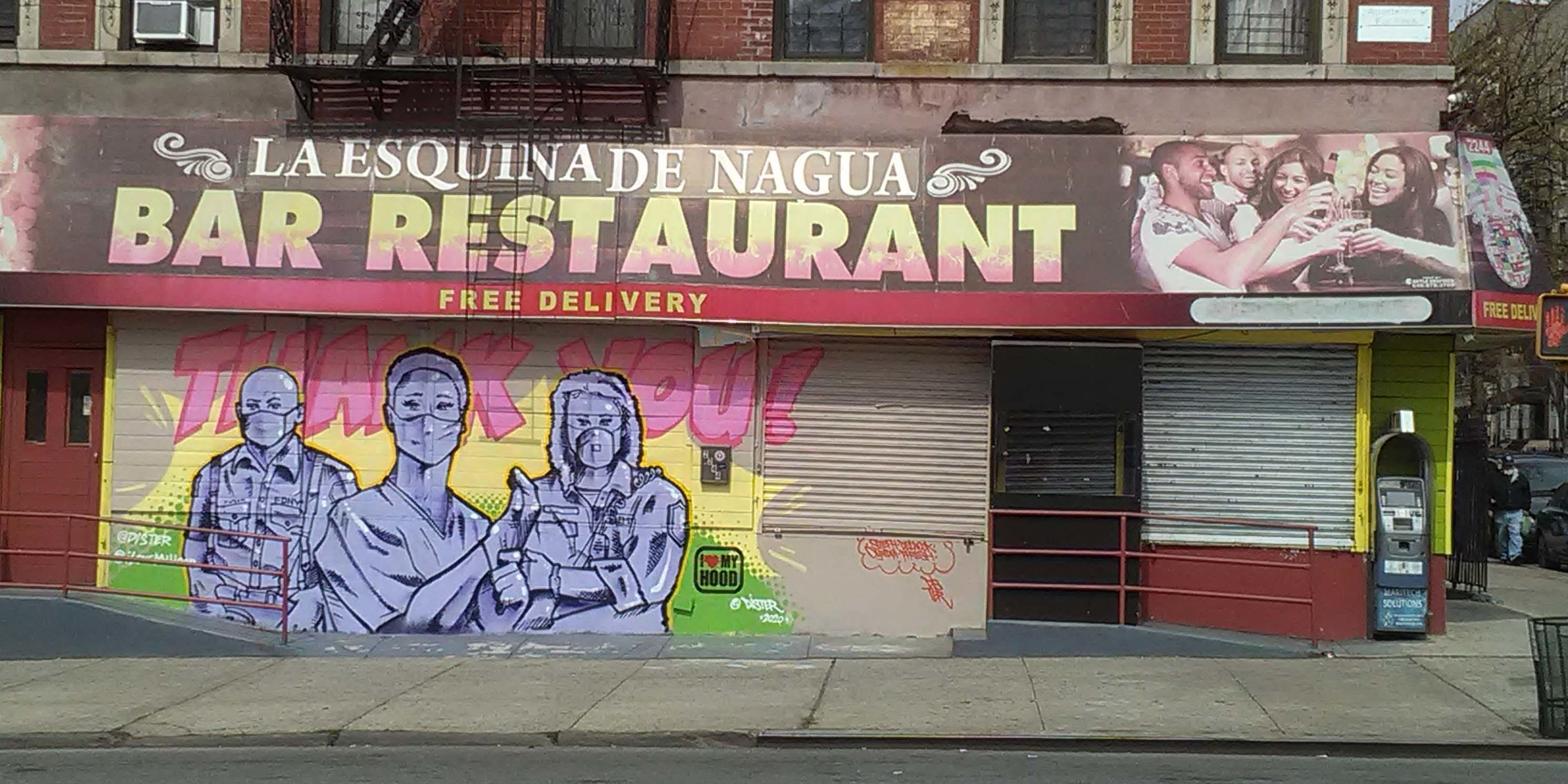 mural depicting medical workers outside a restaurant