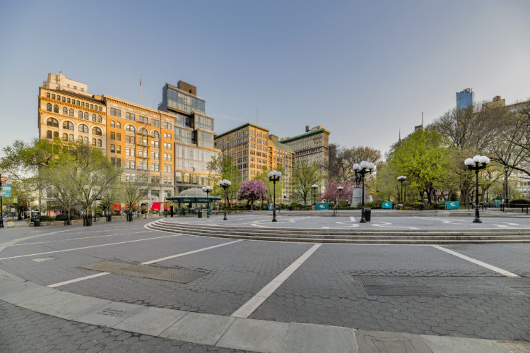 an empty Union Square looking uptown from Broadway