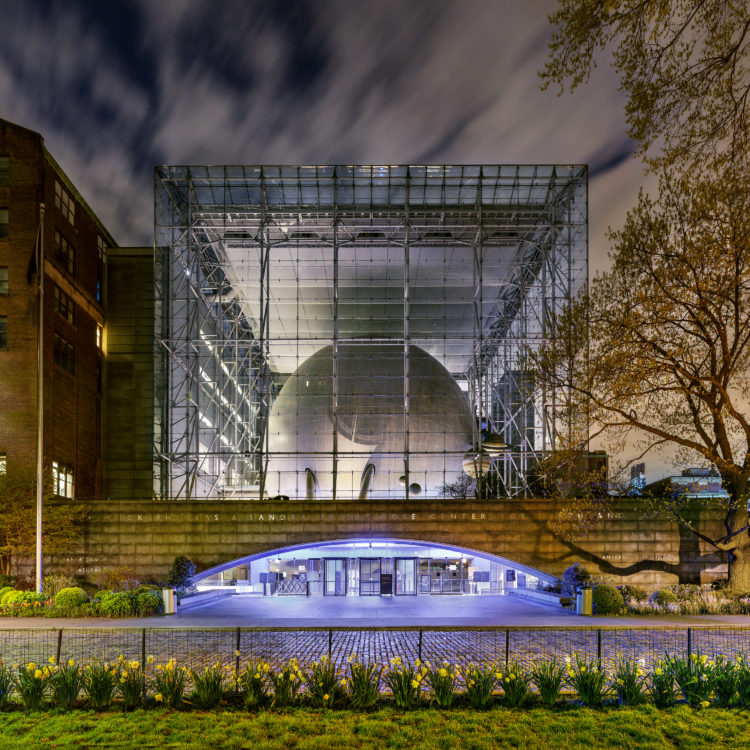 exterior of The Hayden Planetarium at night