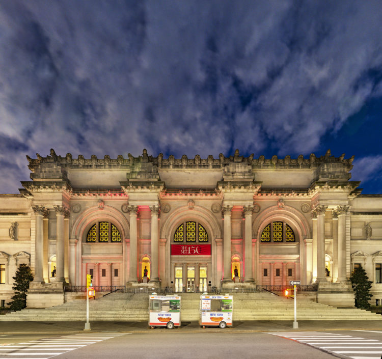 exterior of The Metropolitan Museum of Art at night